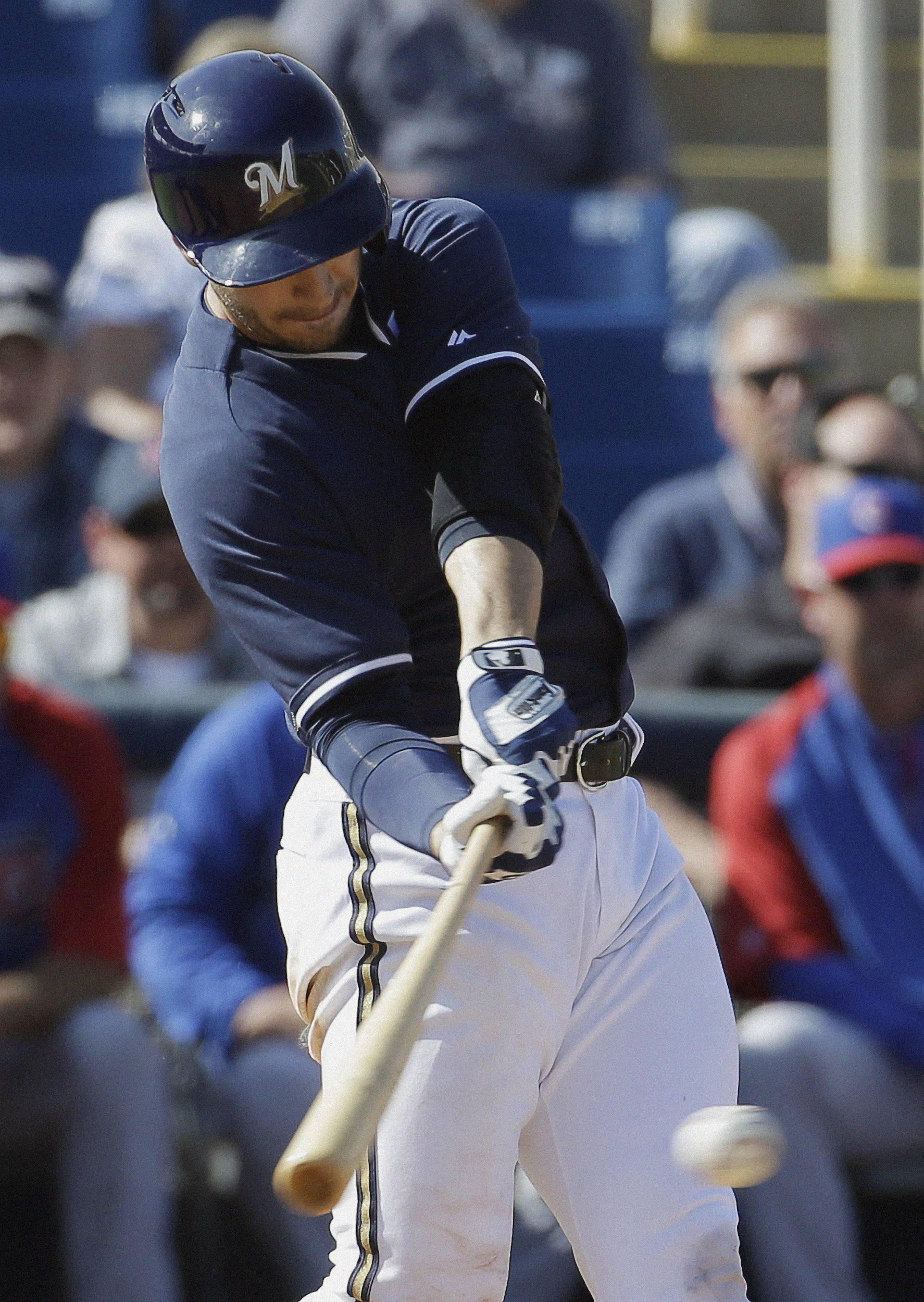 The Brewers' Ryan Braun hits a single during the fifth inning of a spring training game Monday against the Cubs in Phoenix.