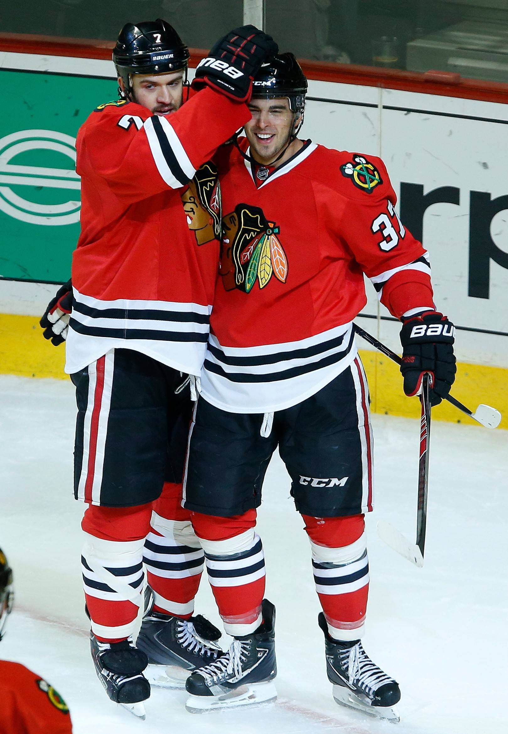 Chicago Blackhawks defenseman Brent Seabrook (7) and center Brandon Pirri (37) celebrate after Pirri scored a goal against the Toronto Maple Leafs during the second period of an Oct. 19 NHL hockey game on in Chicago.