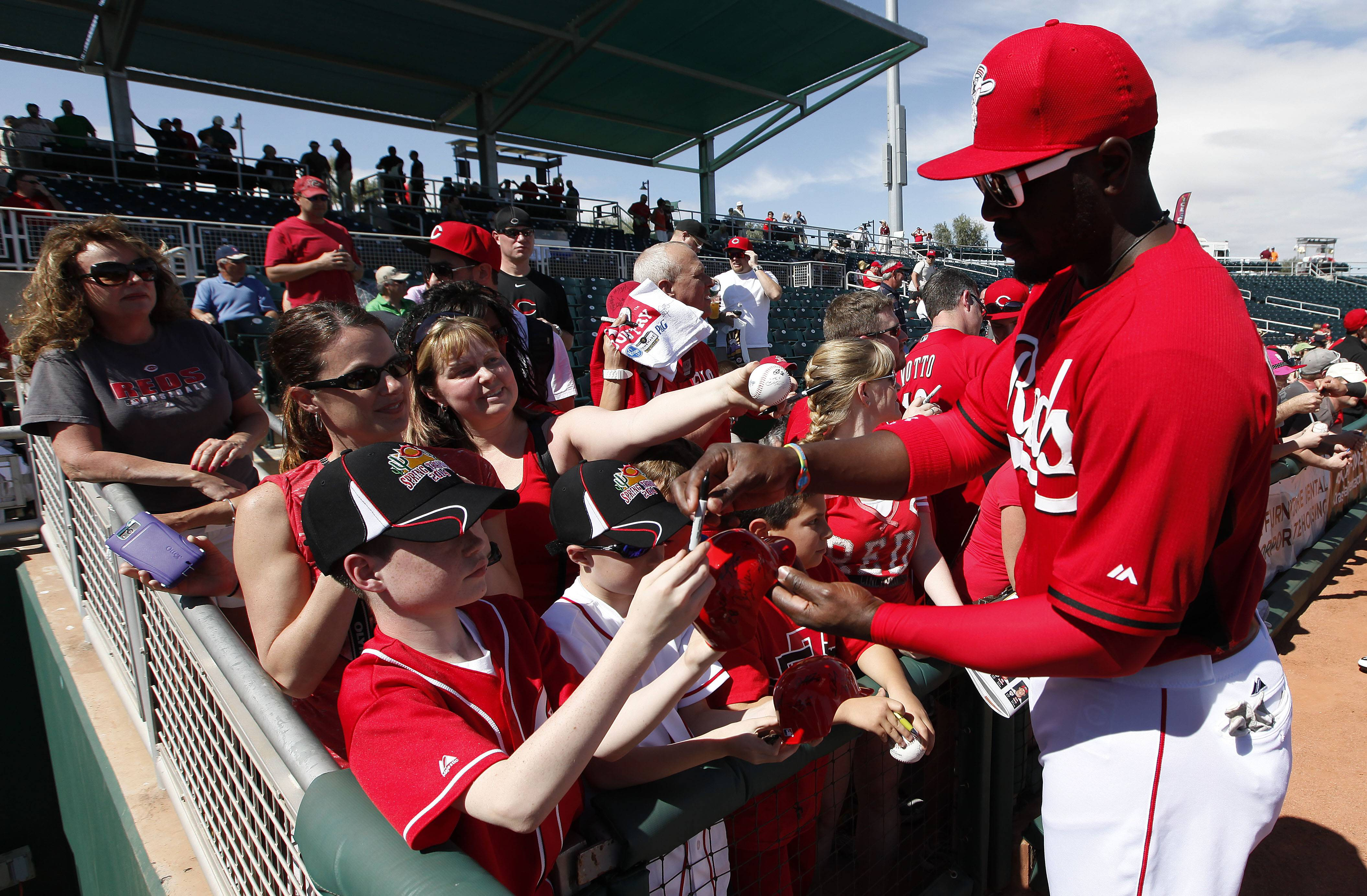 Cincinnati's Brandon Phillips signs autographs before a Feb. 27 exhibition baseball game against the Cleveland Indians in Goodyear, Ariz.