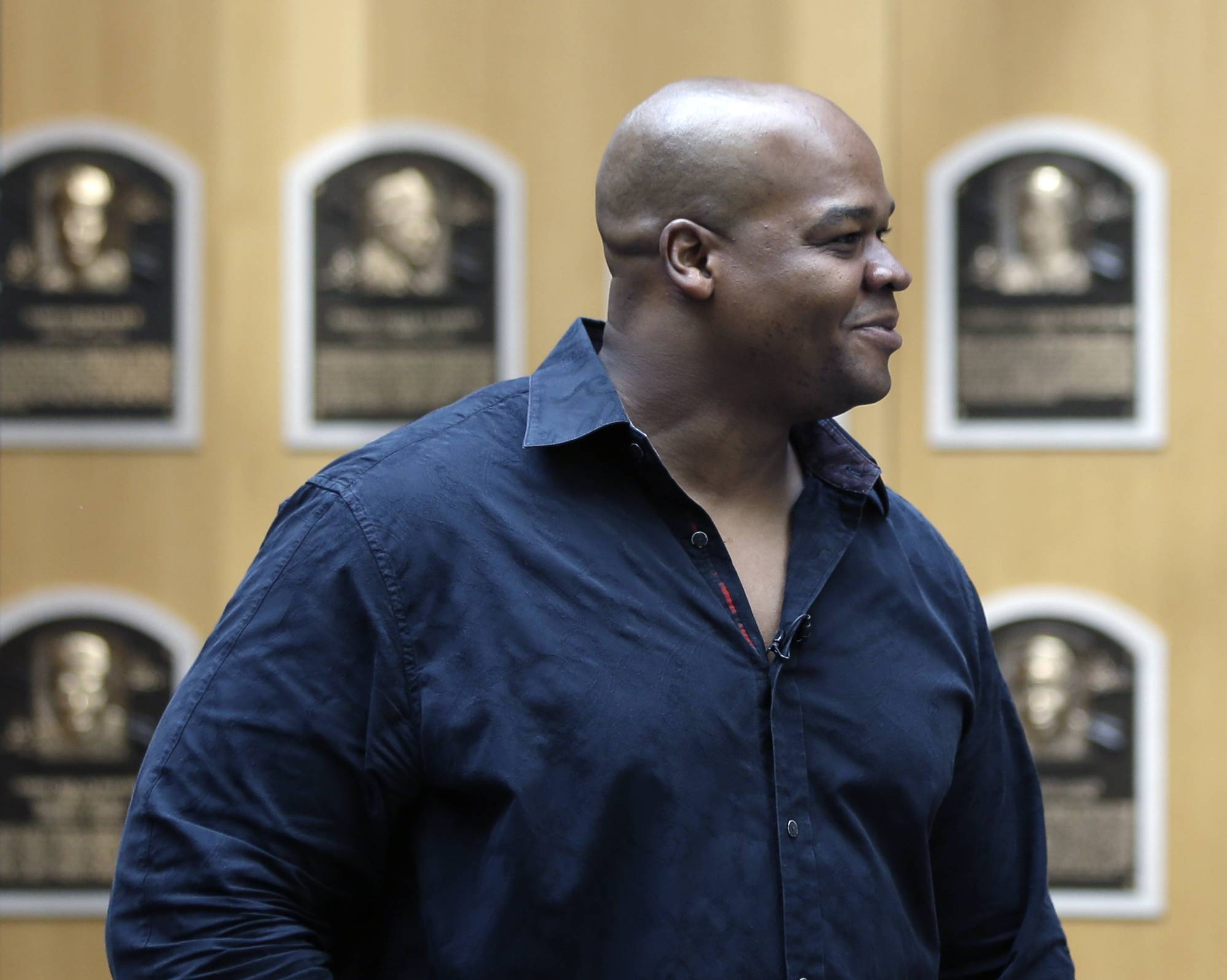Frank Thomas walks in the Plaque Gallery on Monday at the Baseball Hall of Fame.