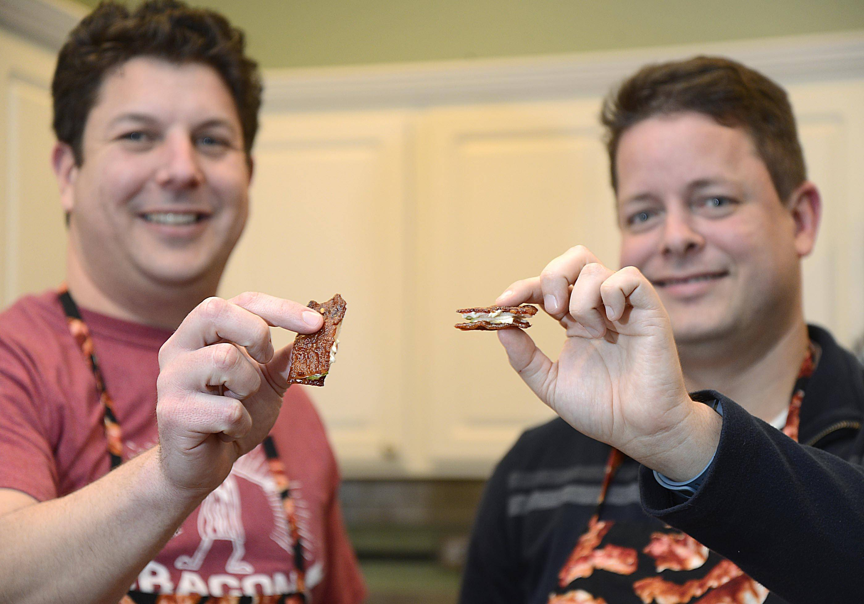 Todd Clement, left, and Ryan Cunningham show off their Sweet and Spicy Piggy Pearwich that earned them second place in their first Bacon Takedown in 2012.
