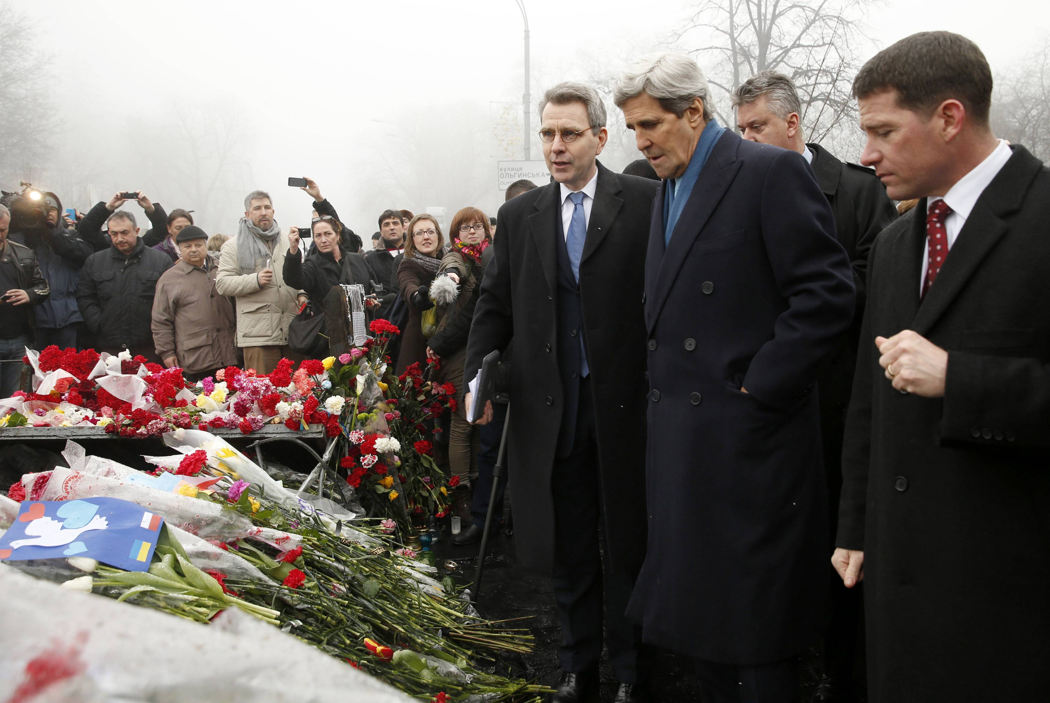 "Secretary of State John Kerry visits the Shrine of the Fallen in Kiev, Ukraine, Tuesday. The Shrine of the Fallen, located on Institutska Street, honors the fallen Heroes of the ""Heavenly Sotnya"" (Hundred). Over the course of the EuroMaidan protests, almost 100 protesters were killed by police."
