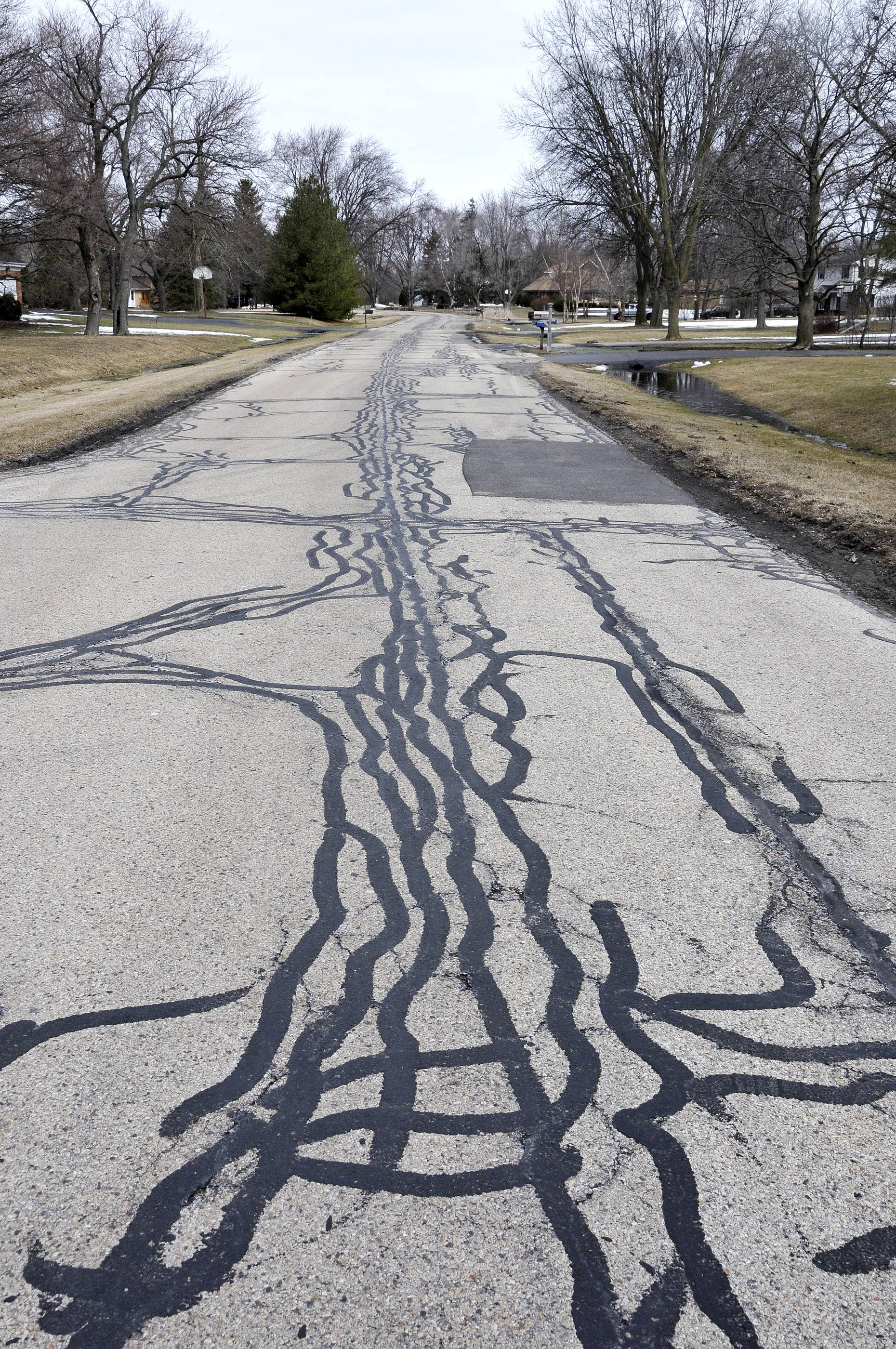 Long Grove officials want to charge the first property tax in the village's history to pay for repairs to deteriorating roads.