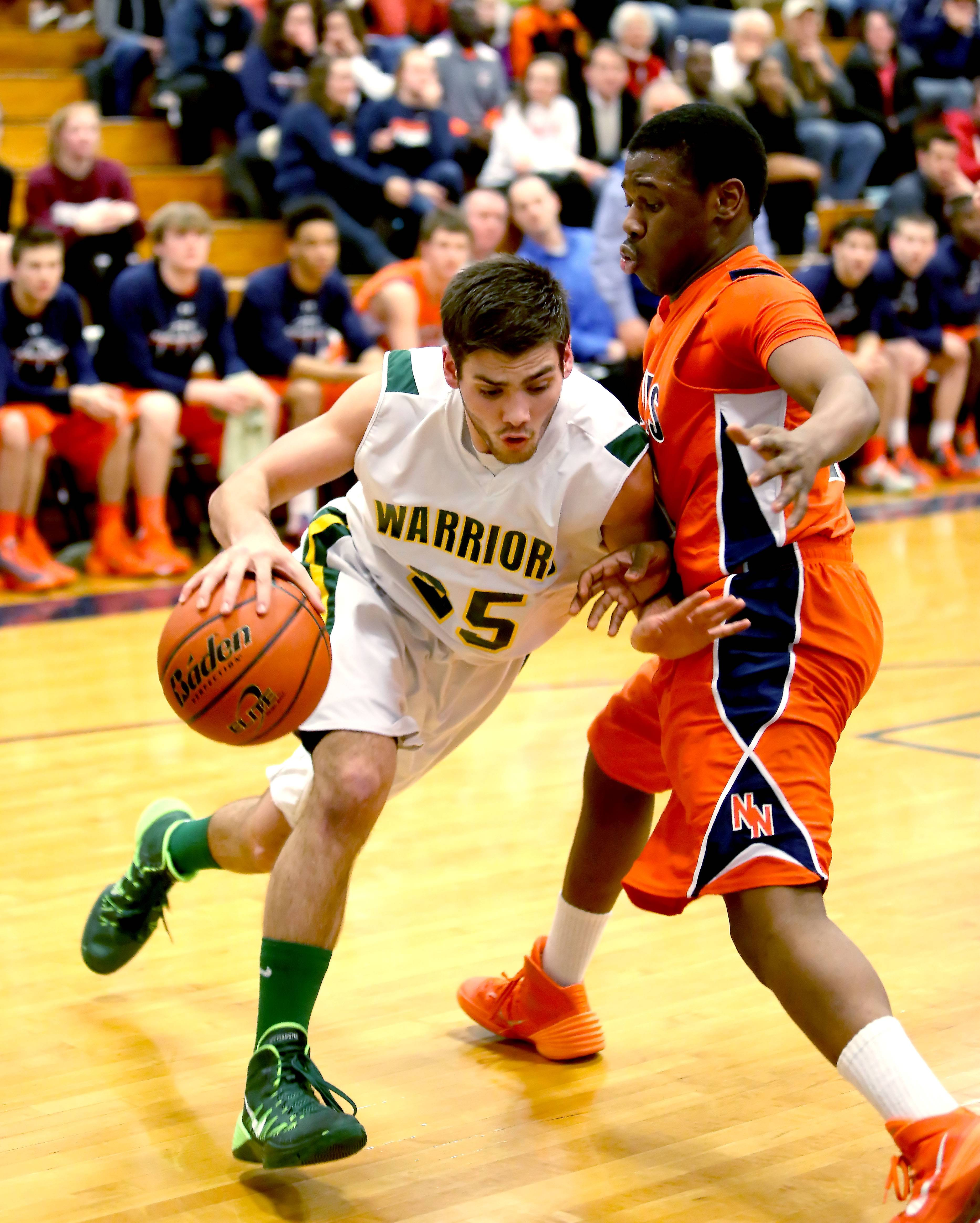 Waubonsie Valley's Matt Gialamas, left, drives past Jelani McClain Jr., right of Naperville North during Class 4A regional boys basketball in Lemont on Tuesday.