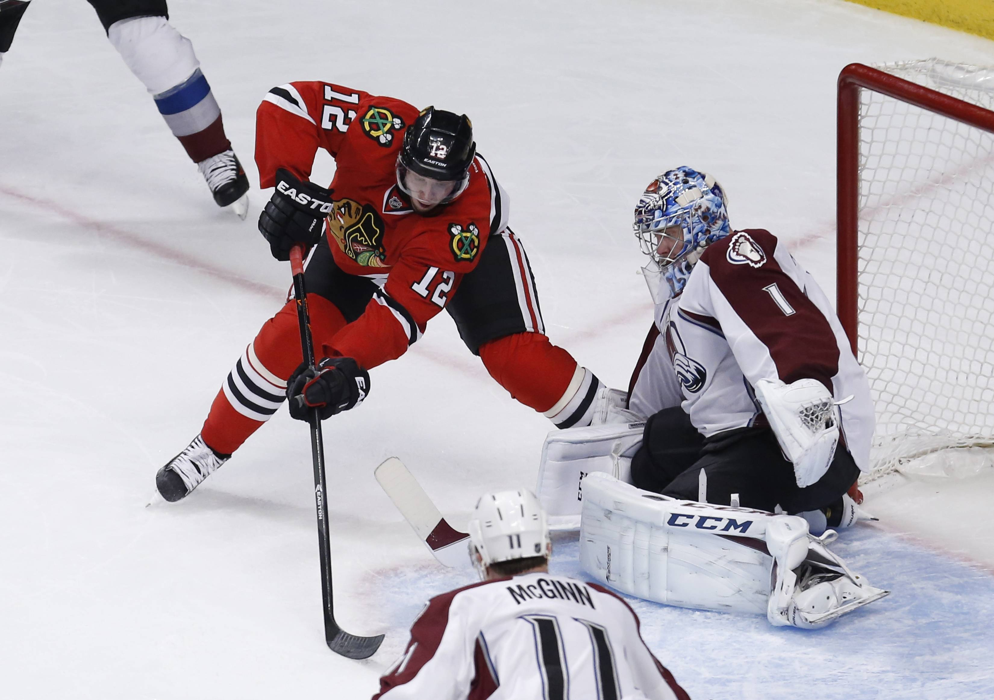 Avalanche goalie Semyon Varlamov makes a save on a shot by Blackhawks center Peter Regin during the second period Tuesday night.