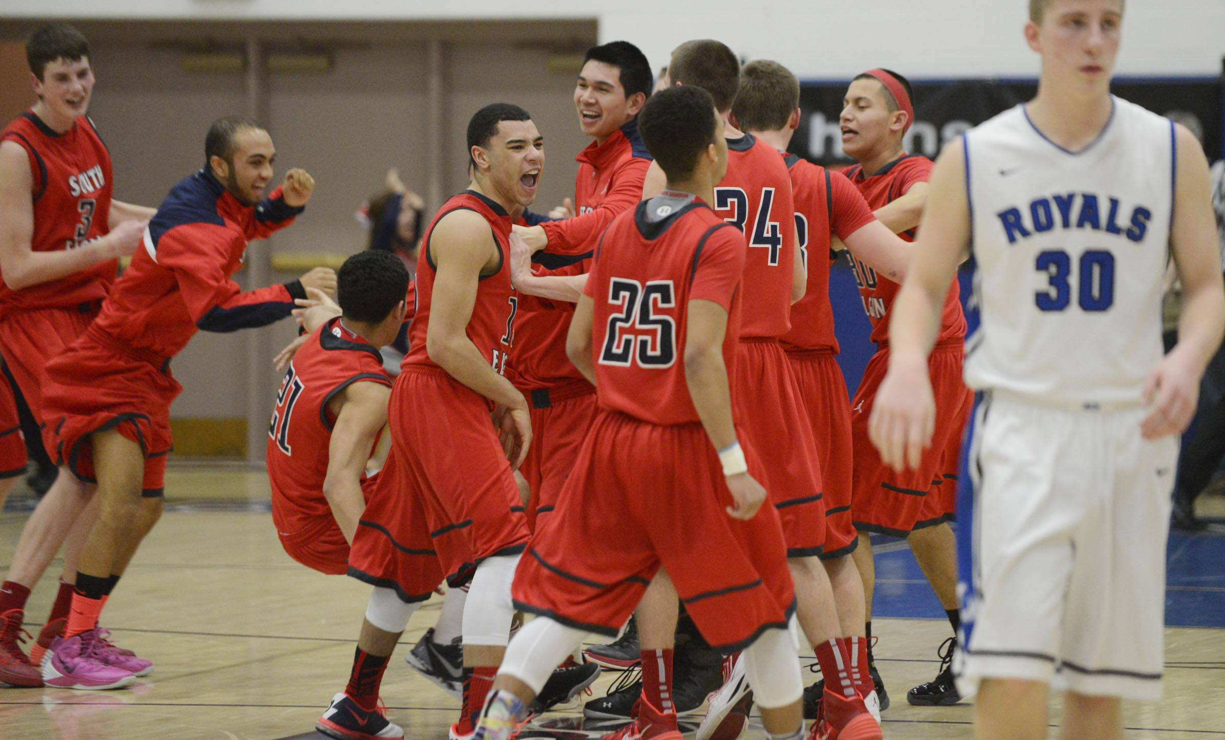 South Elgin celebrates their win Tuesday in the St. Charles North regional game against the Larkin Royals.