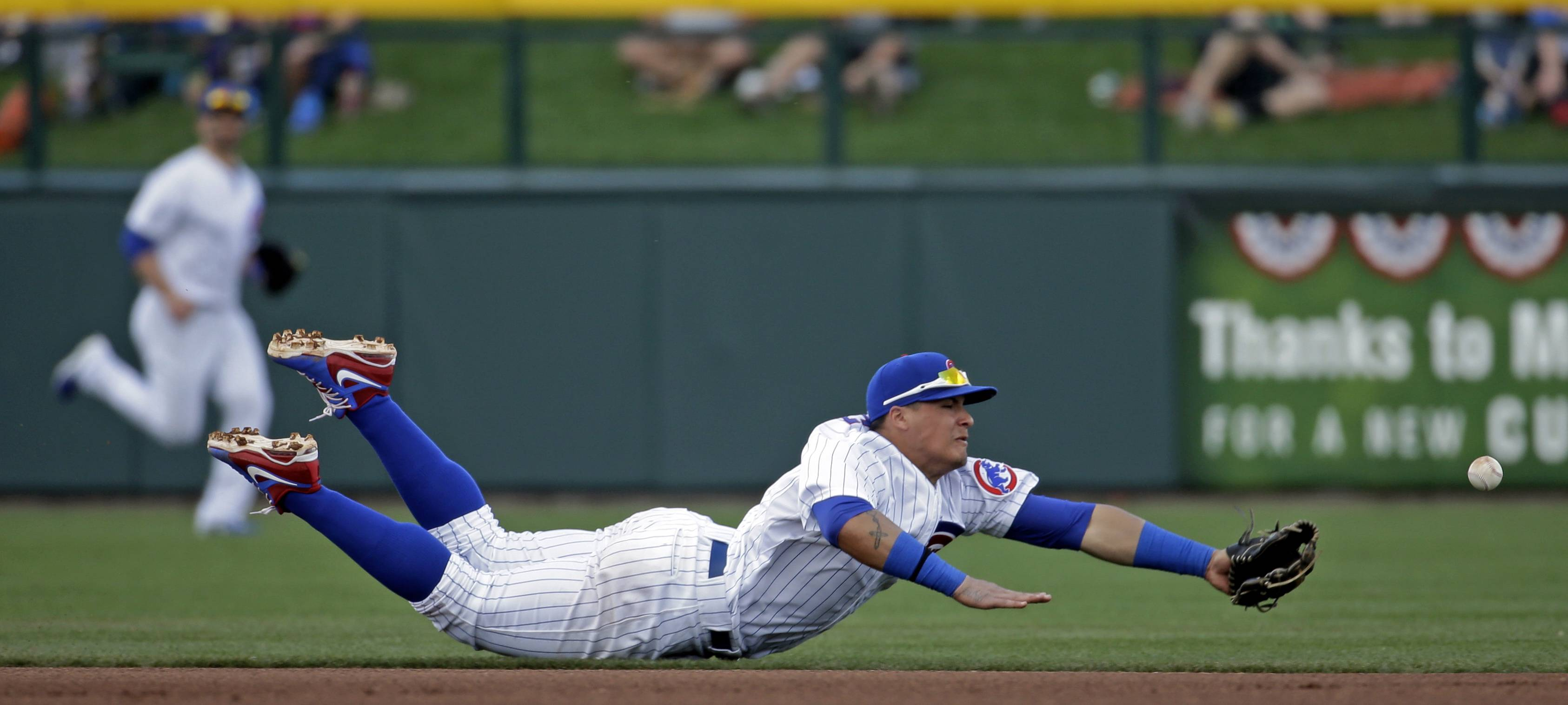 Javier Baez can't come up with a ball hit by Kansas City's Lorenzo Cain on Sunday. Baez could be a mid-season call-up, but Mike Imrem wishes the Cubs would just let him begin the season with the big club.