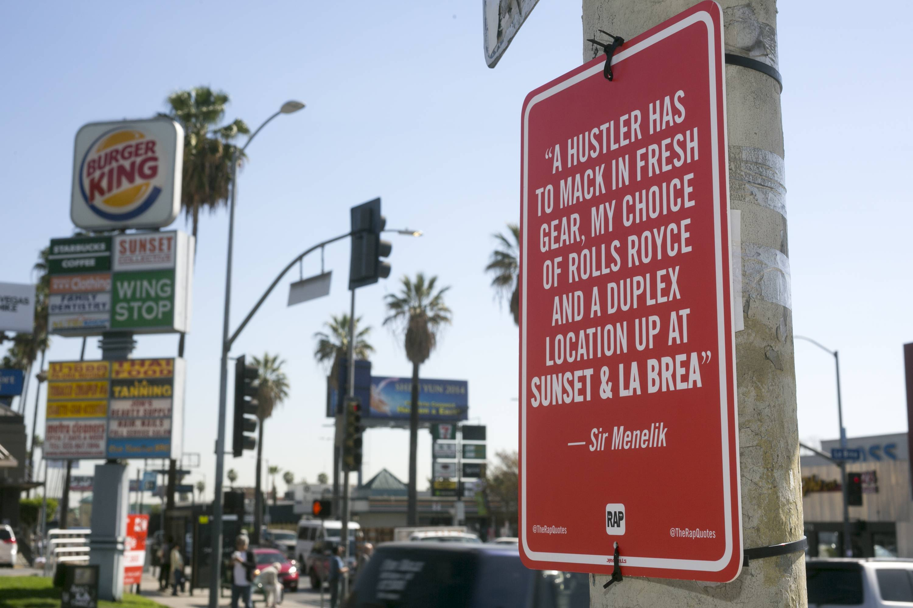 A hip-hop themed banner is on display at the intersection of Sunset Boulevard and La Brea Avenue in Los Angeles. Street artist Jay Shells installed the sign after one day when he caught the name of a nearby intersection cited in a hip-hop song he'd been playing. Shells has put up scores of carefully drawn, hand-screened signs featuring the words of other rappers.