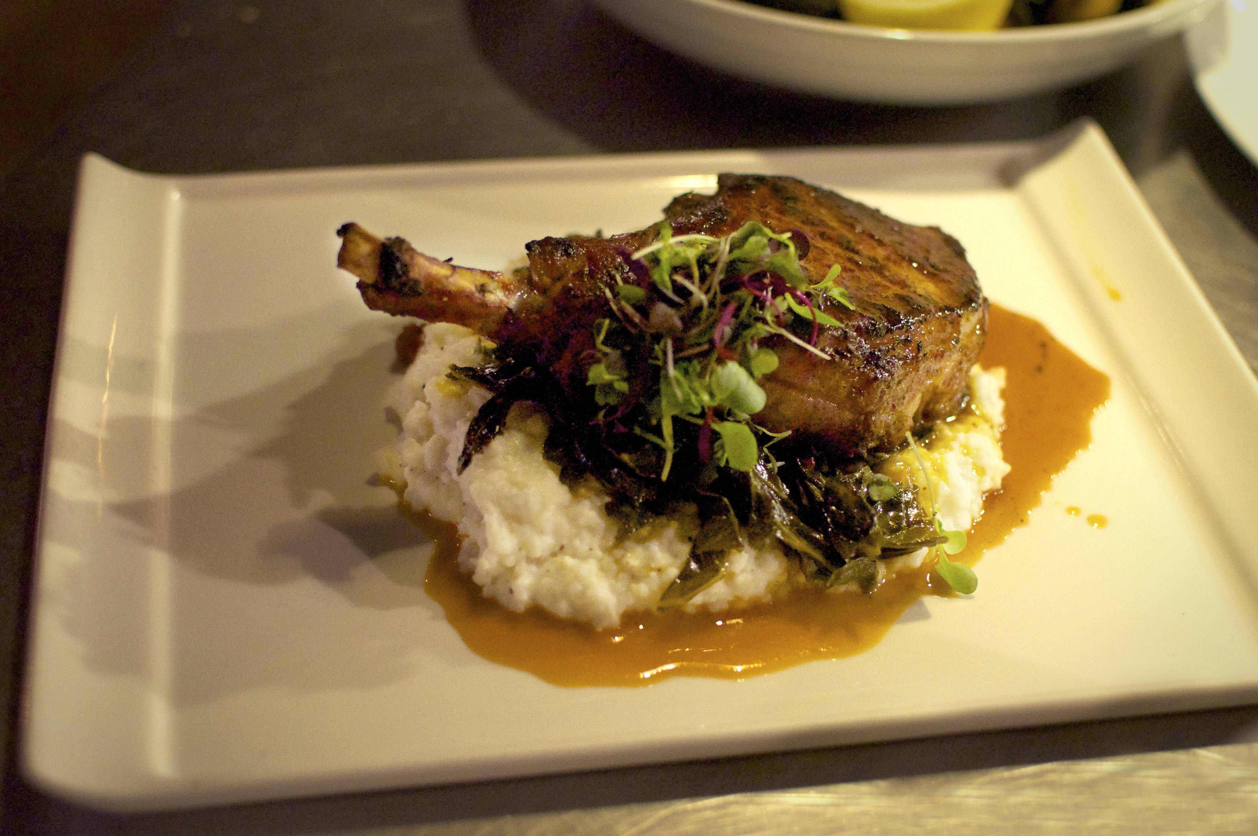 Diners at the Admiral in Asheville, N.C., can find dishes like the Heritage Farms Pork Chop on the ever-changing menu.