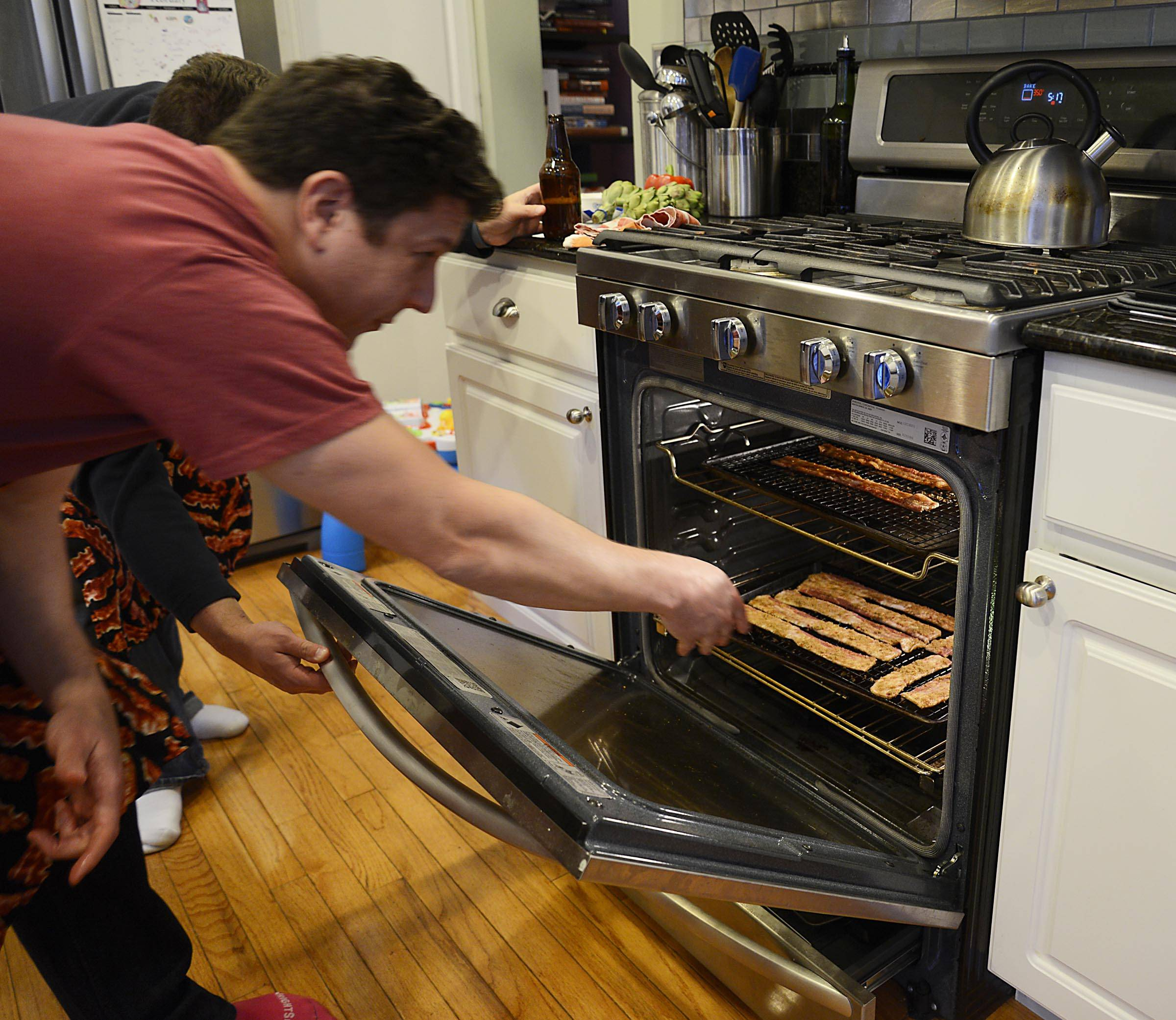 Todd Clement bakes the bacon that will be used to make Sweet and Spicy Piggy Pearwich.
