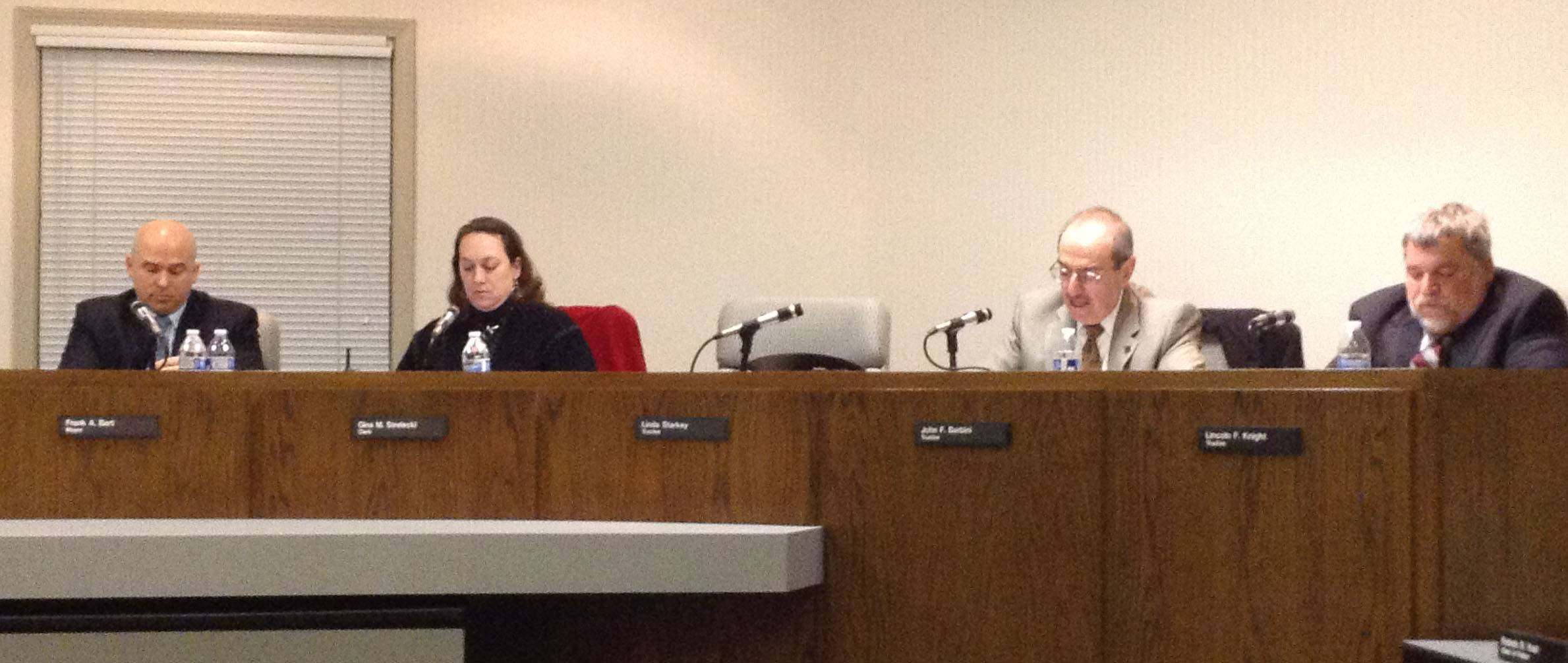 Wauconda Trustee John Barbini, second from right, talks about the 911 call center outsourcing proposal on Tuesday night.