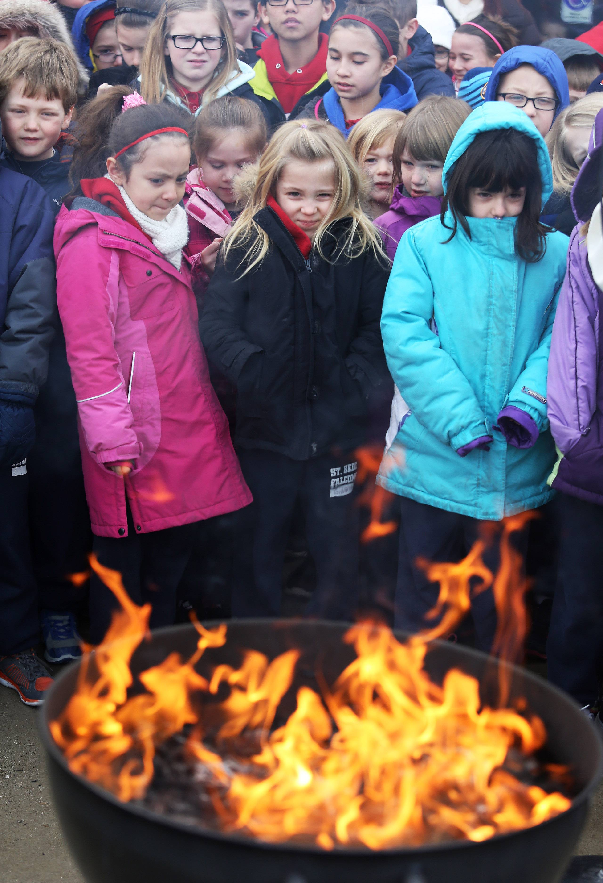 St. Bede Catholic School students watch palms burn during a ceremony Tuesday in Ingleside. The Rev. Rodolfo Ramirez conducted the ritual in preparation for Ash Wednesday services.