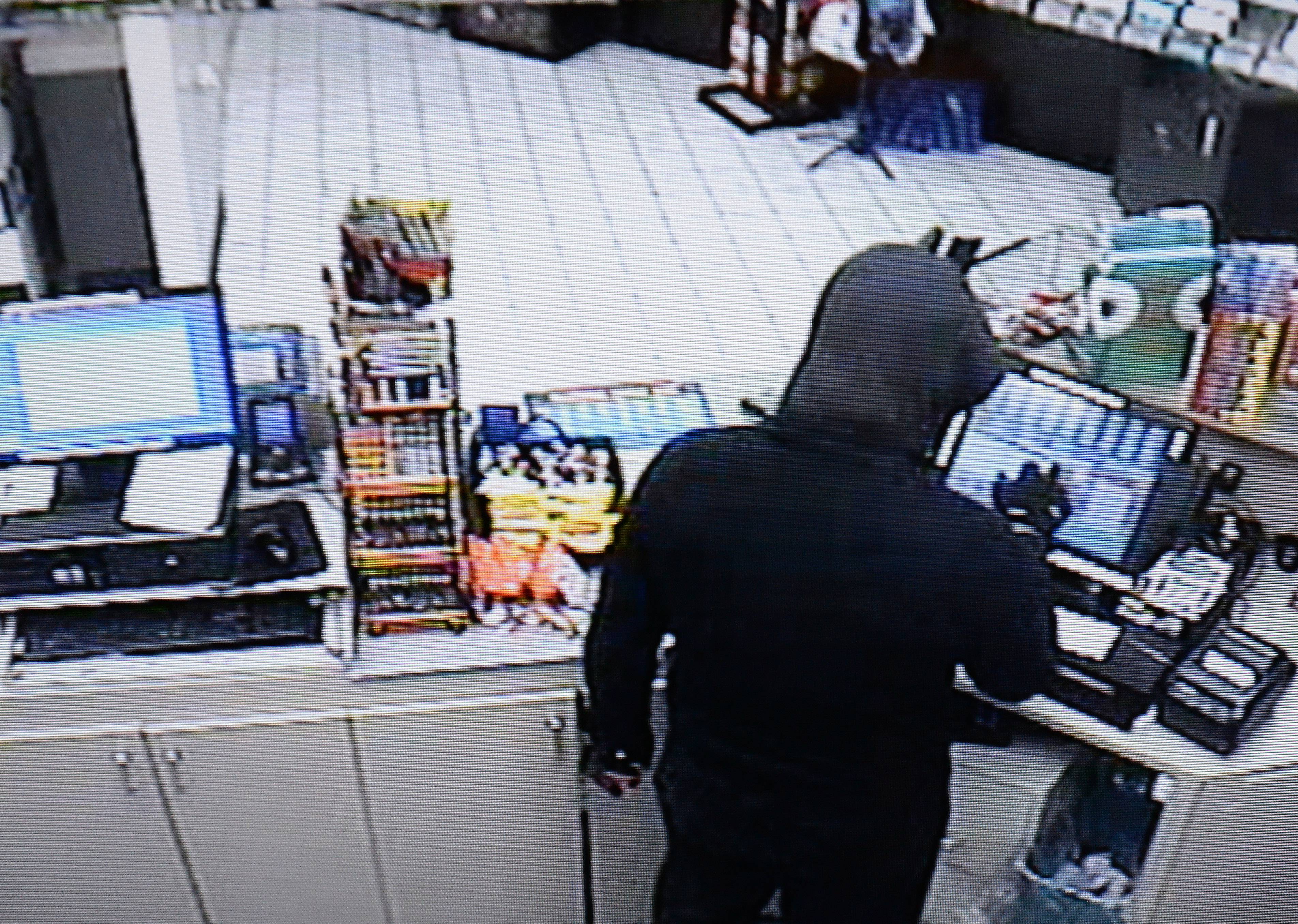 Police say the suspect in the March 2013 slaying of a Streamwood gas station attendant went to great lengths to avoid detection, wearing wore a hood, mask and gloves during the crime. Police released new surveillance video of the man Tuesday.