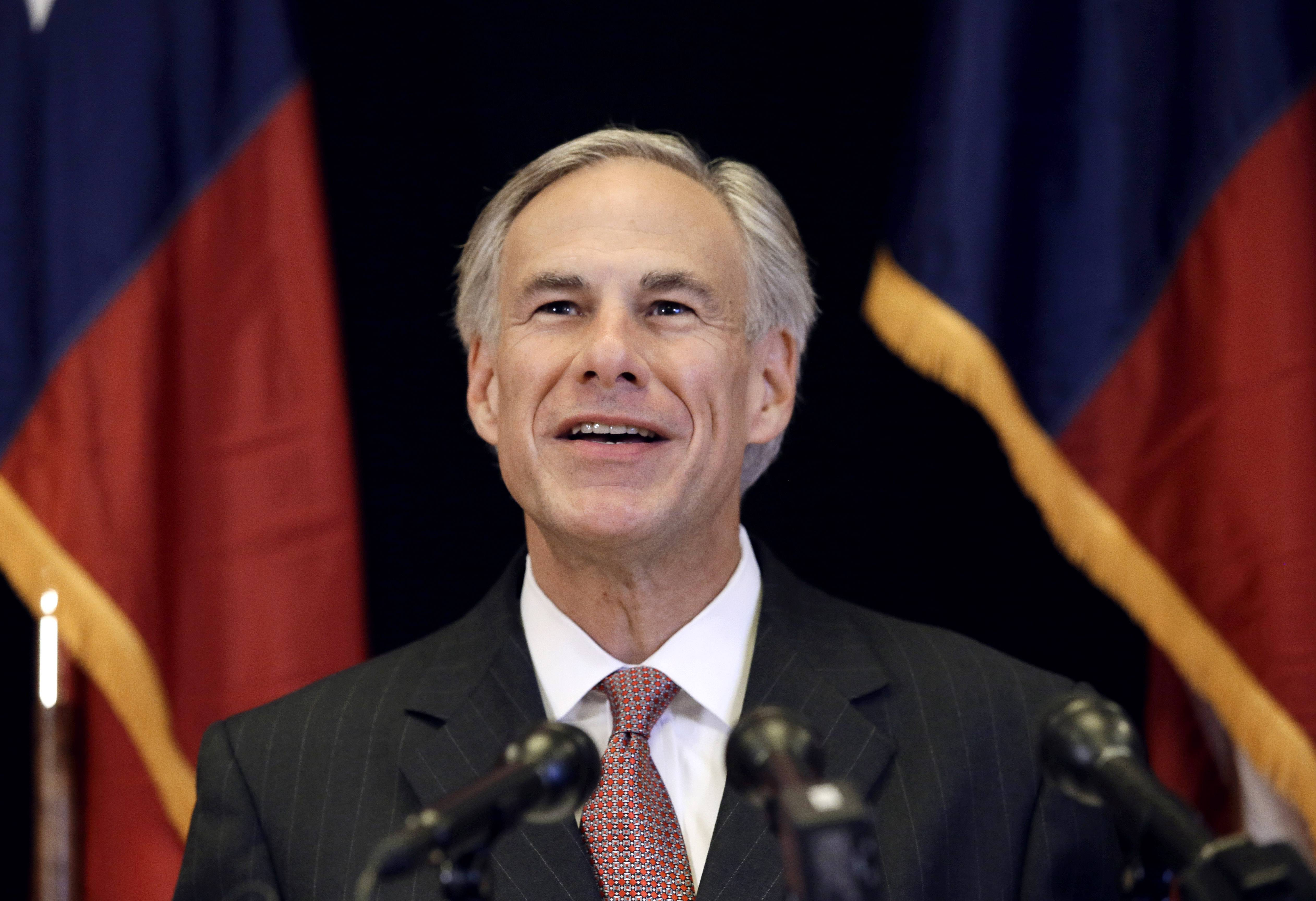 FILE - In this Nov. 4, 2013 file photo, Republican candidate for governor, Texas Attorney General Greg Abbott smiles as he responds to a reporter's questions during a news conference in Dallas. In the nation's first primary of the season, Texas politicians scramble to fill a void left by an extraordinary shakeup in state offices.