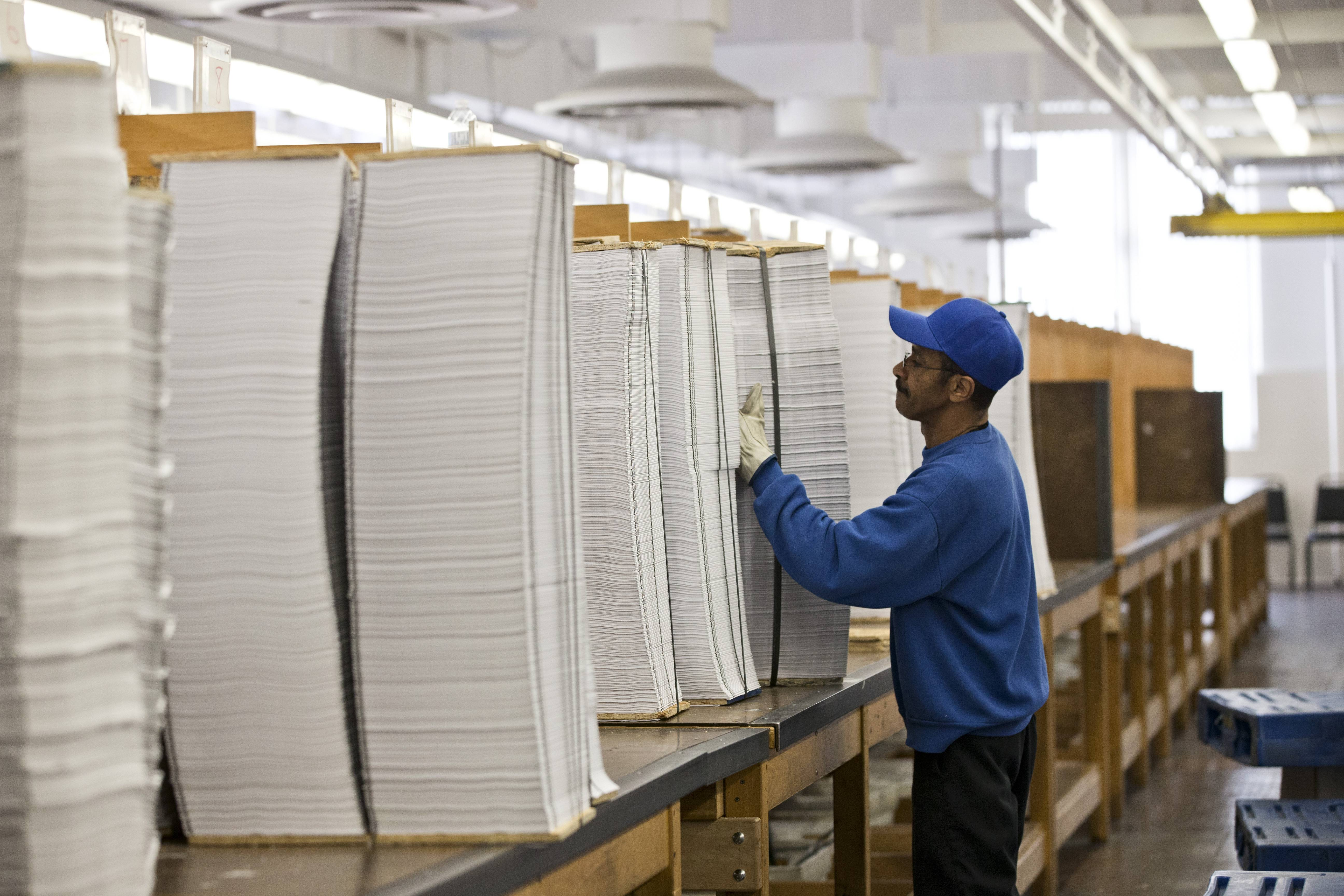 Printed copies of President Barack Obama's proposed budget plan for fiscal year 2014 are prepared for binding at the U.S. Government Printing Office in Washington.