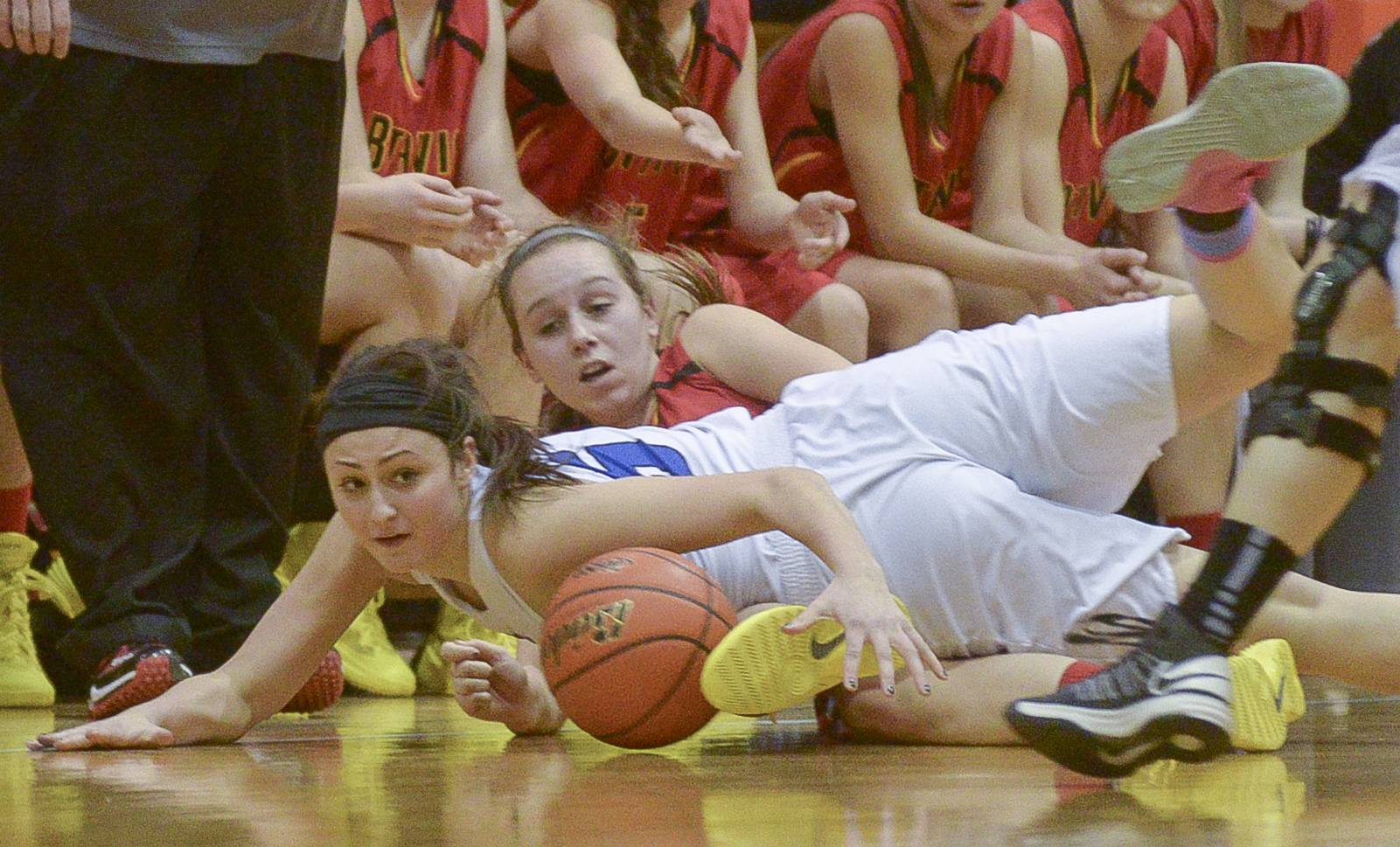 Geneva's Abby Novak and Batavia's Bethany Orman scramble on the ground for control of the ball during Thursday's Class 4A girls basketball sectional final in Addison.