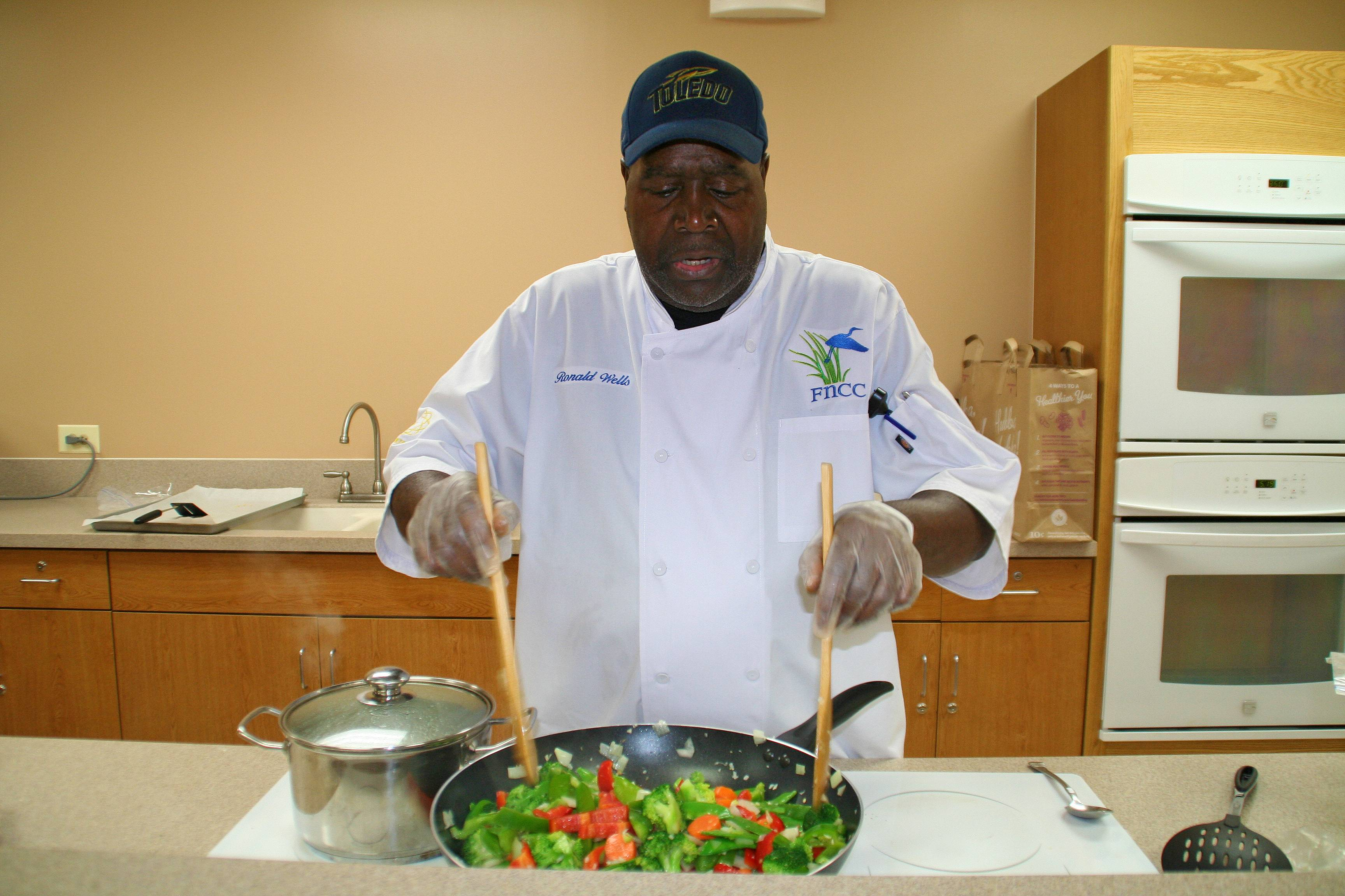 """The magic of a great stir-fry with crispy vegetables is the quick tumbling and tossing in a hot wok,"" Wells said at the Feb. 20, Joyful Chinese cooking class at Prairie Lakes Community Center."