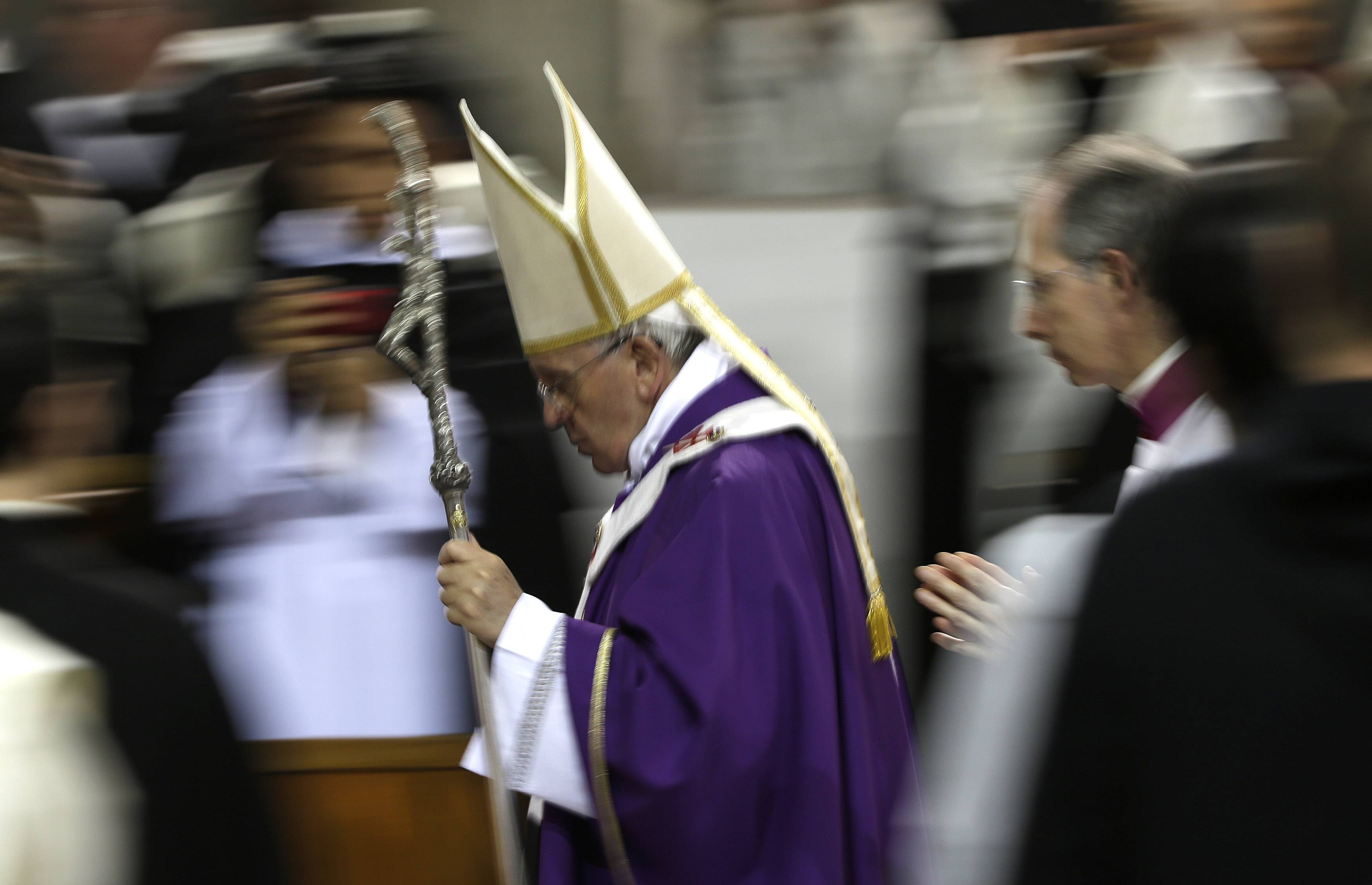 Pope Francis leaves after celebrating the Ash Wednesday mass at the Santa Sabina Basilica in Rome.