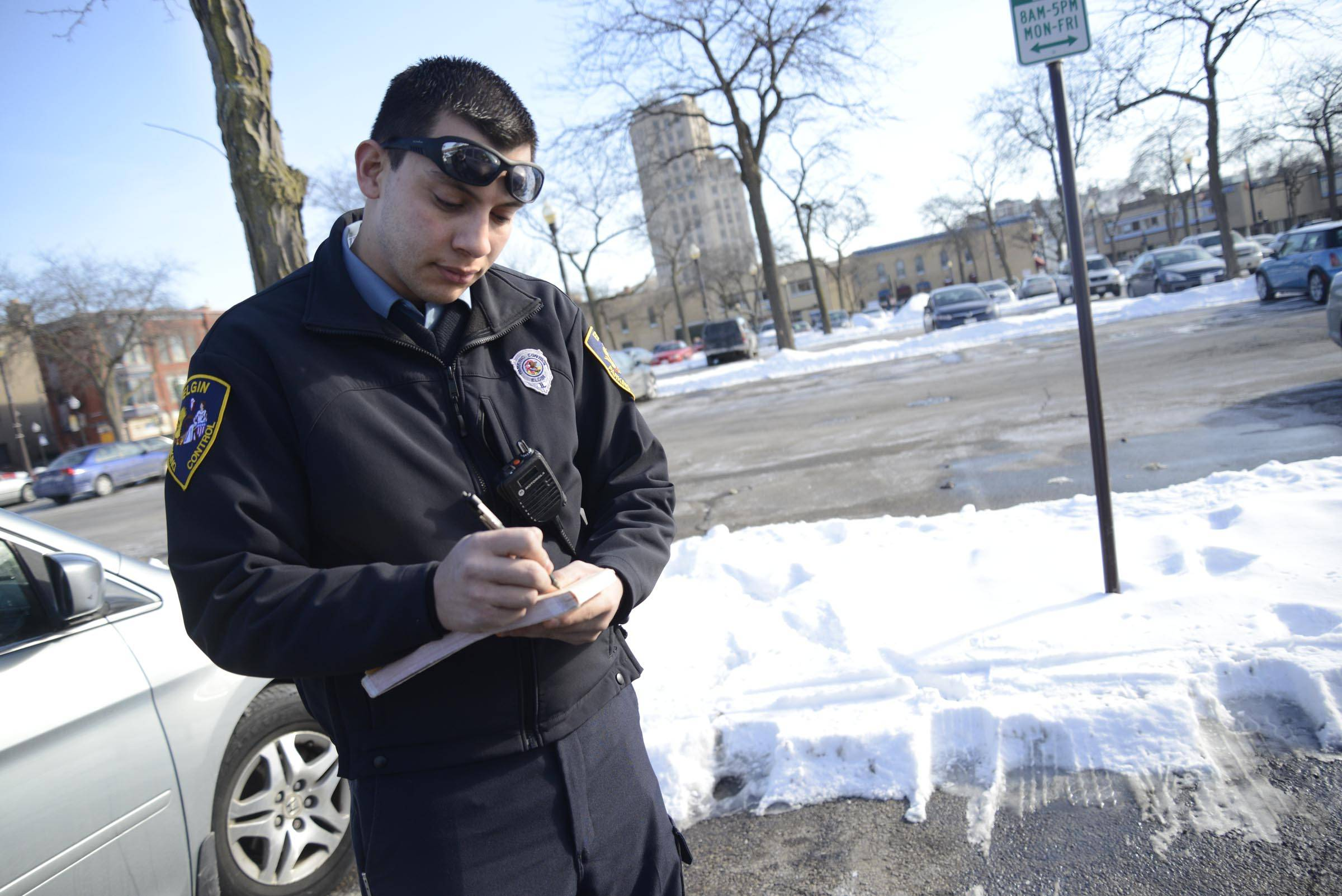 Jose Gutierrez, 20, is a member of the Elgin Police Explorer program and works part-time as a parking control officer. He wants to become a police officer, but current rules say he can't qualify for hiring until he has a bachelor's degree.