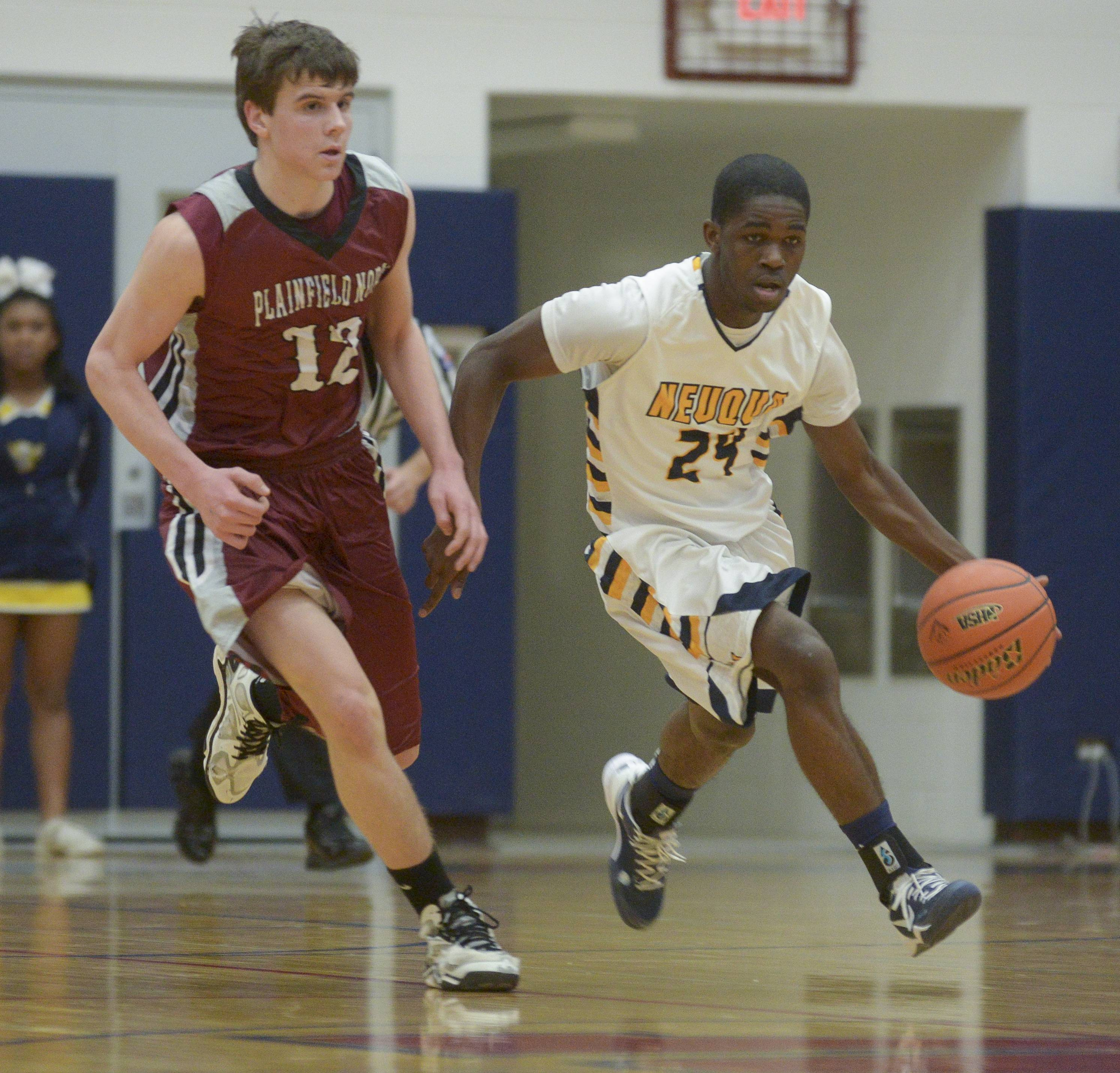 Neuqua Valley's Demond George drives around down court past Plainfield North's Trevor Stumpe.