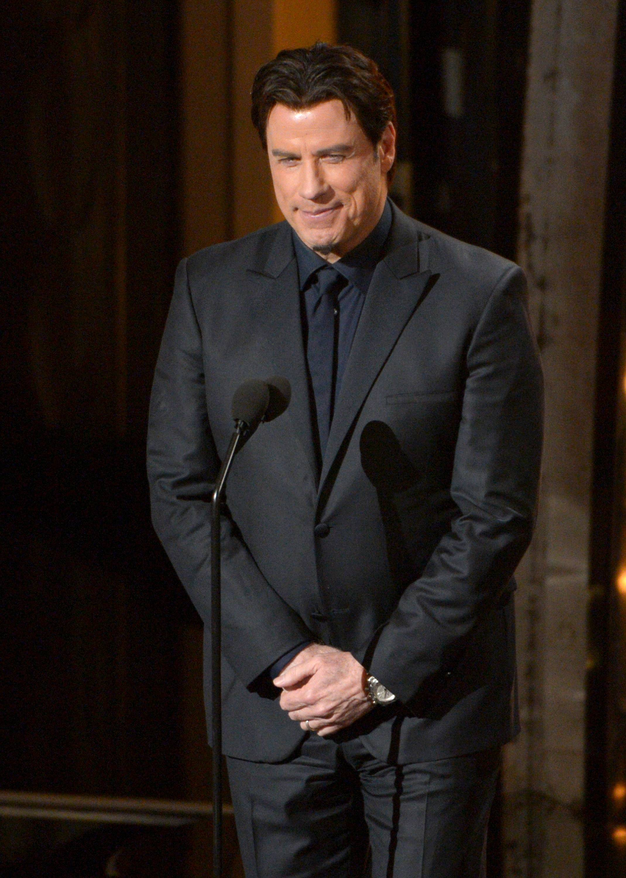 John Travolta has apologized to Tony Award winner Idina Menzel for mangling the pronunciation of her name during the Oscars telecast Sunday.