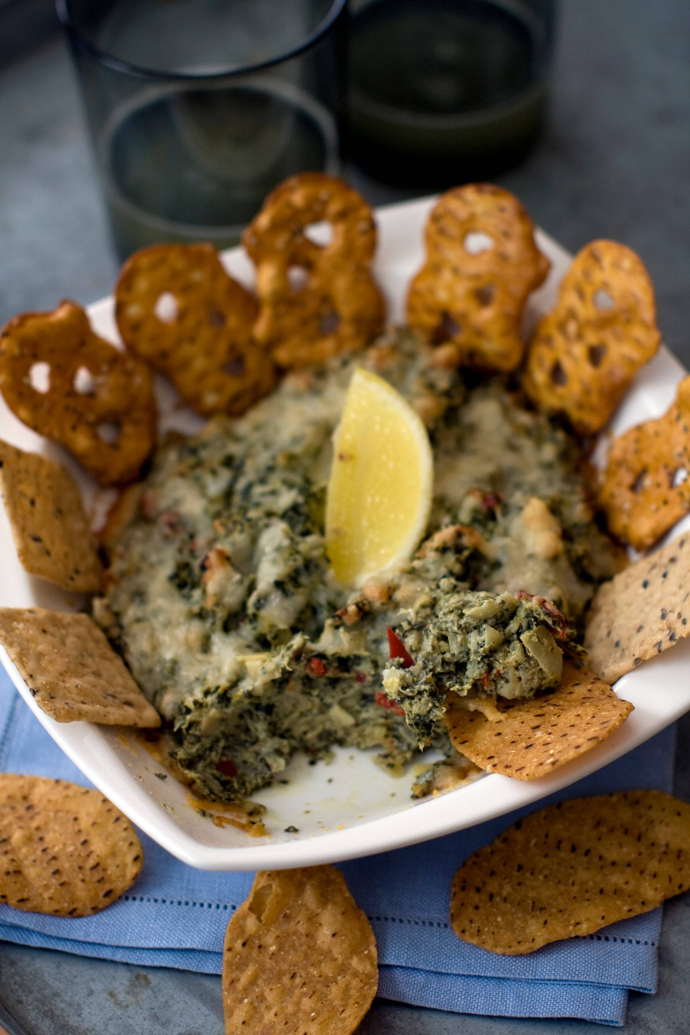 Enjoy the looming basketball madness nearly guilt free with this healthier take on hot artichoke spinach dip.