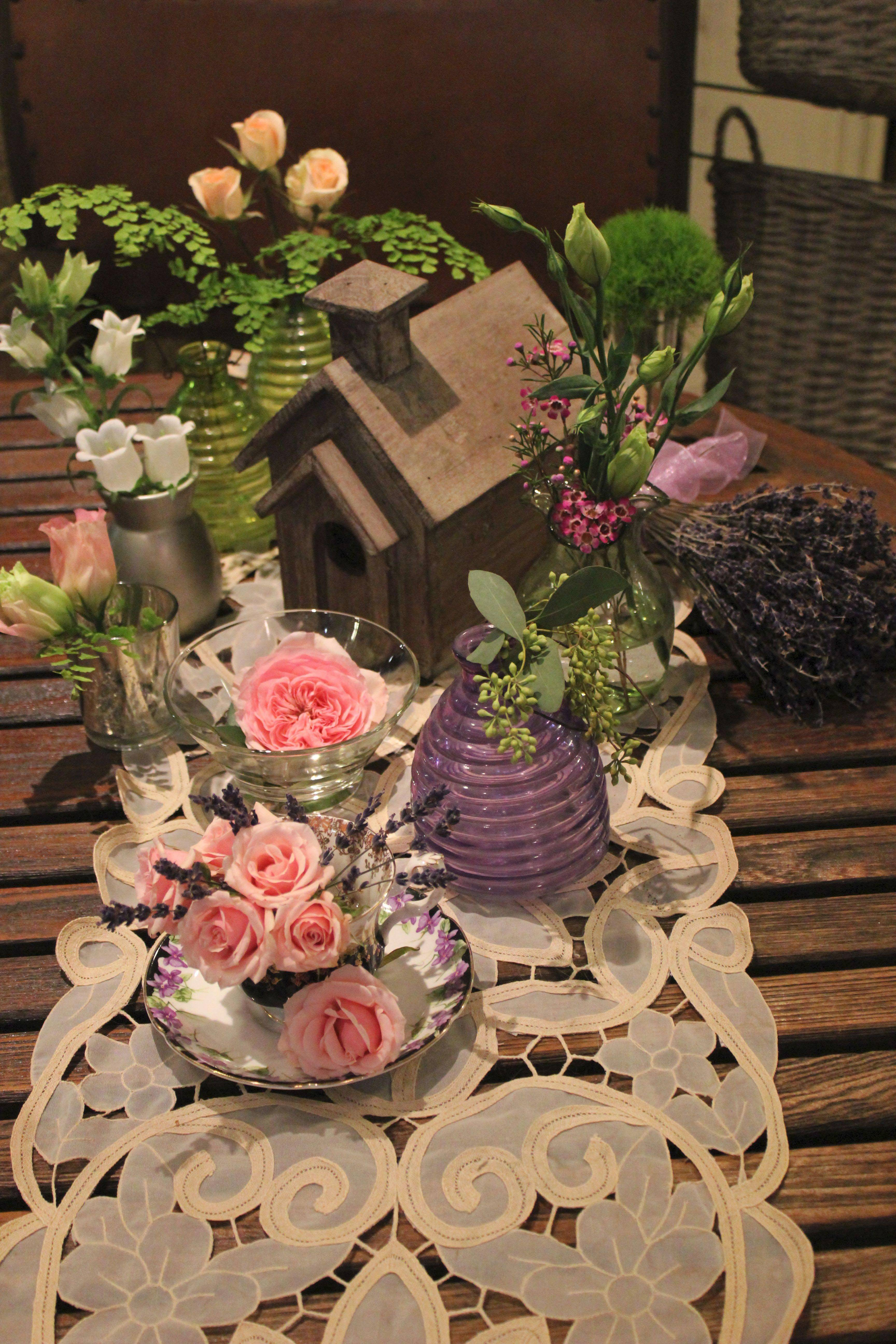 COLLECTIBLES AS CONTAINERS: Little antique bottles from yard sales, old milk bottles and old pitchers will stand out in arrangements. Put several of these containers on a tray with a single flower in each -- perhaps a rose in one, a hydrangea in another -- creating a tablescape across your dining table.