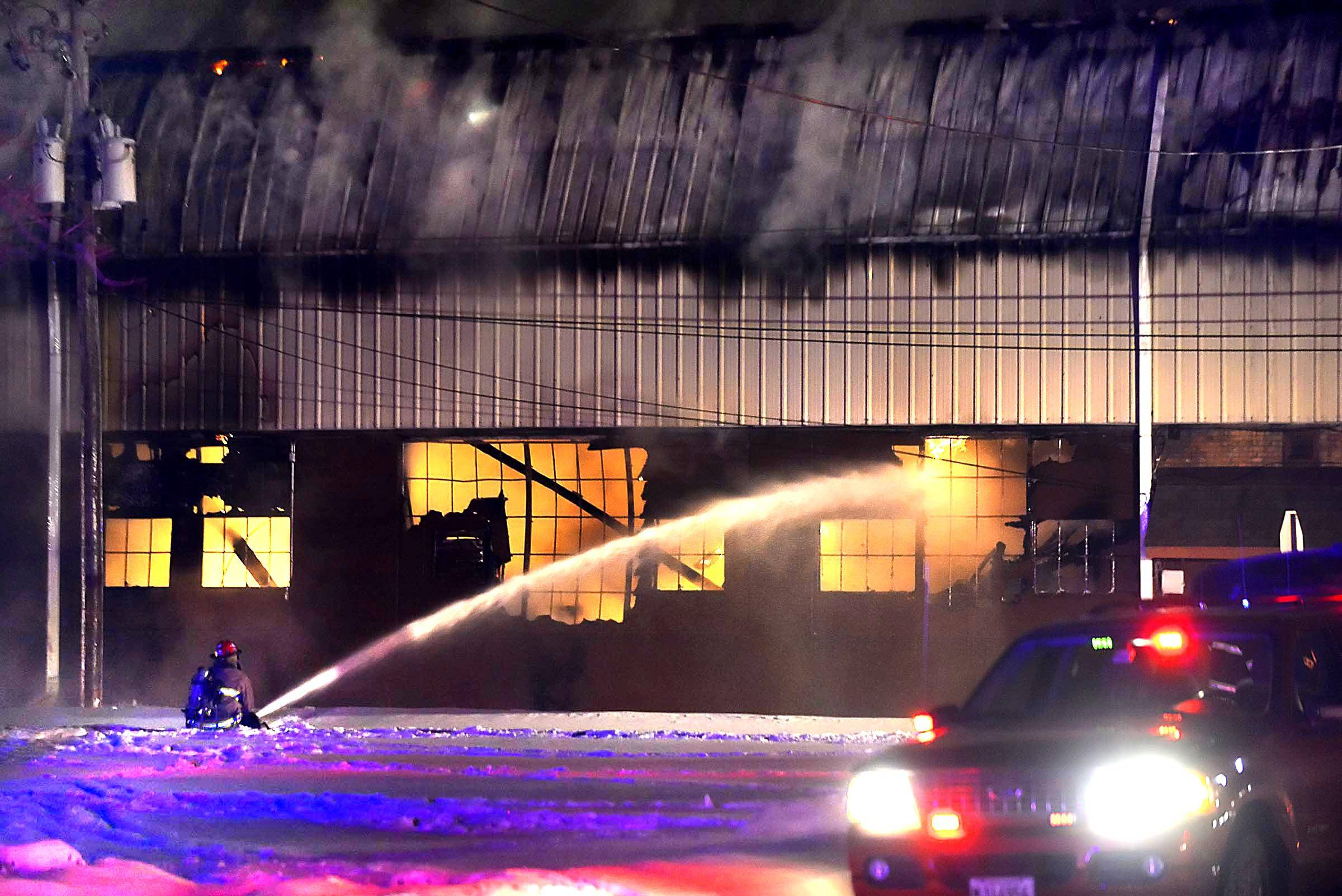 Several fire departments work on a fire at First Street in Batavia late Wednesday night.