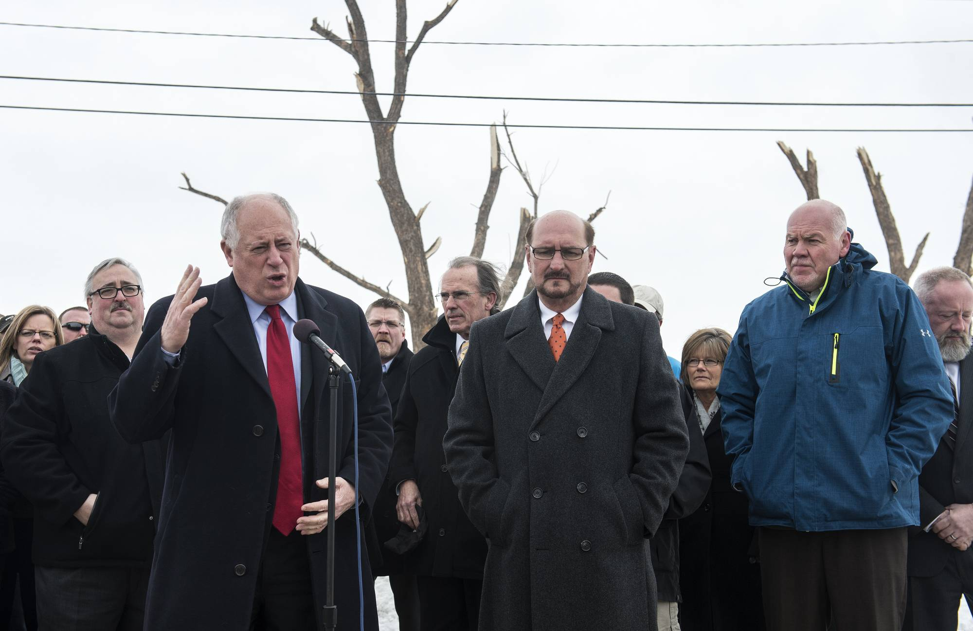 Gov. Pat Quinn, left, announces $45 million in Illinois-funded relief for local governments recovering from the deadly November tornadoes during a news conference Wednesday outside of Tractor Supply Co. in downstate Washington. Joining the governor were Washington Mayor Gary Manier, center, and East Peoria Mayor Dave Mingus.