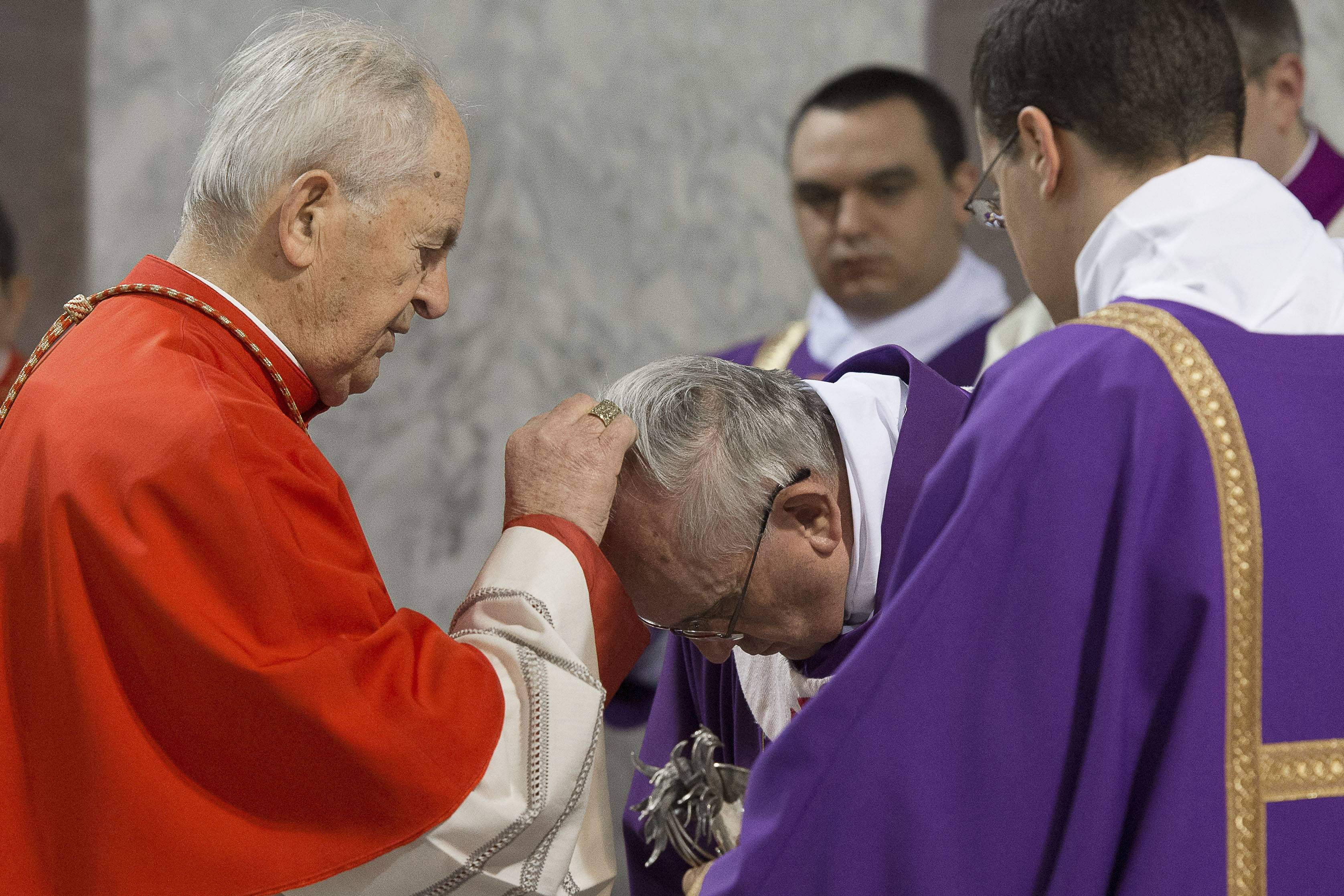 Pope Francis is sprinkled with ashes during the Ash Wednesday mass at the Santa Sabina Basilica in Rome.