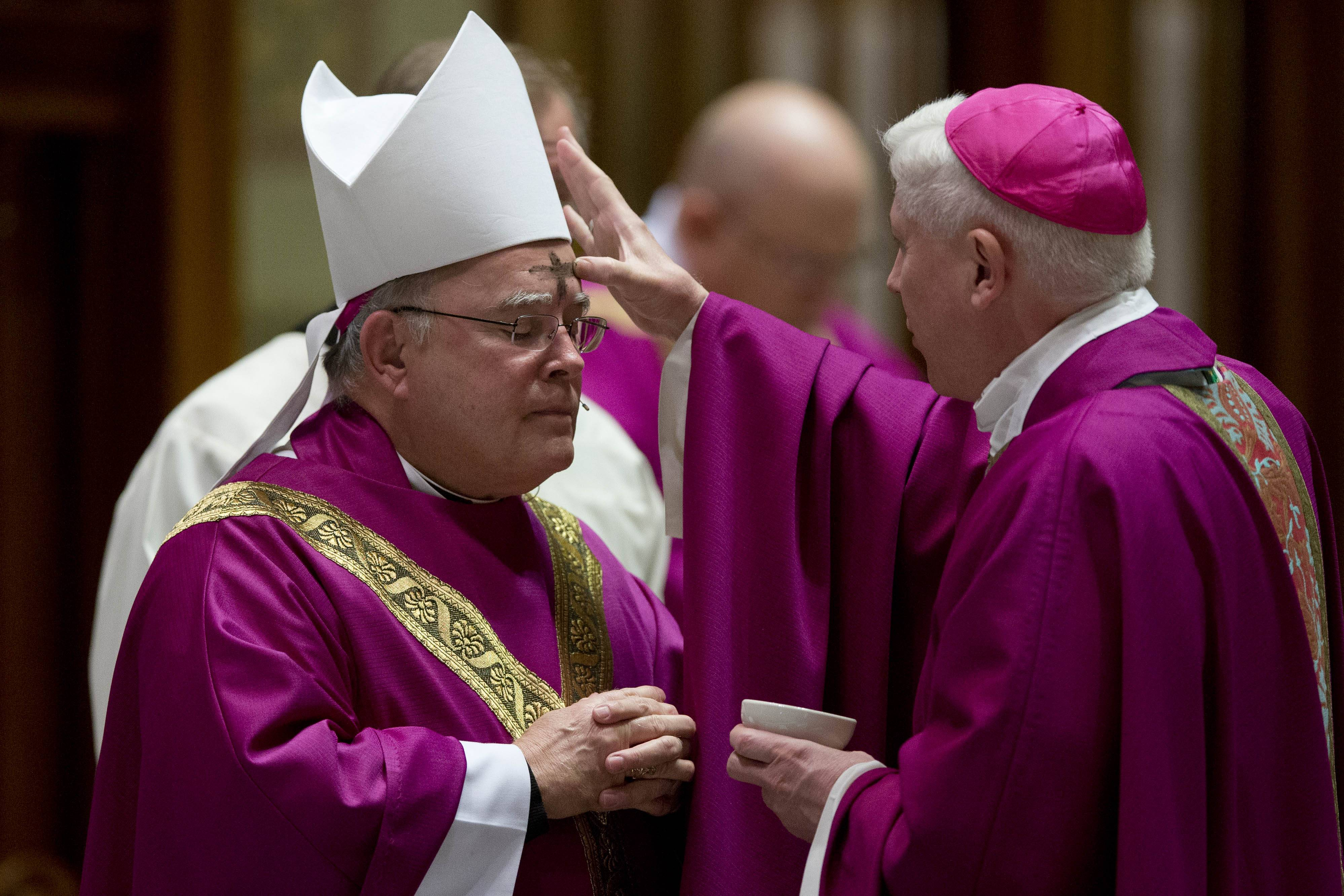 Archbishop of Philadelphia Charles Chaput has ash on a placed on his forehead during an Ash Wednesday Mass at the Cathedral Basilica of Saints Peter and Paul in Philadelphia.