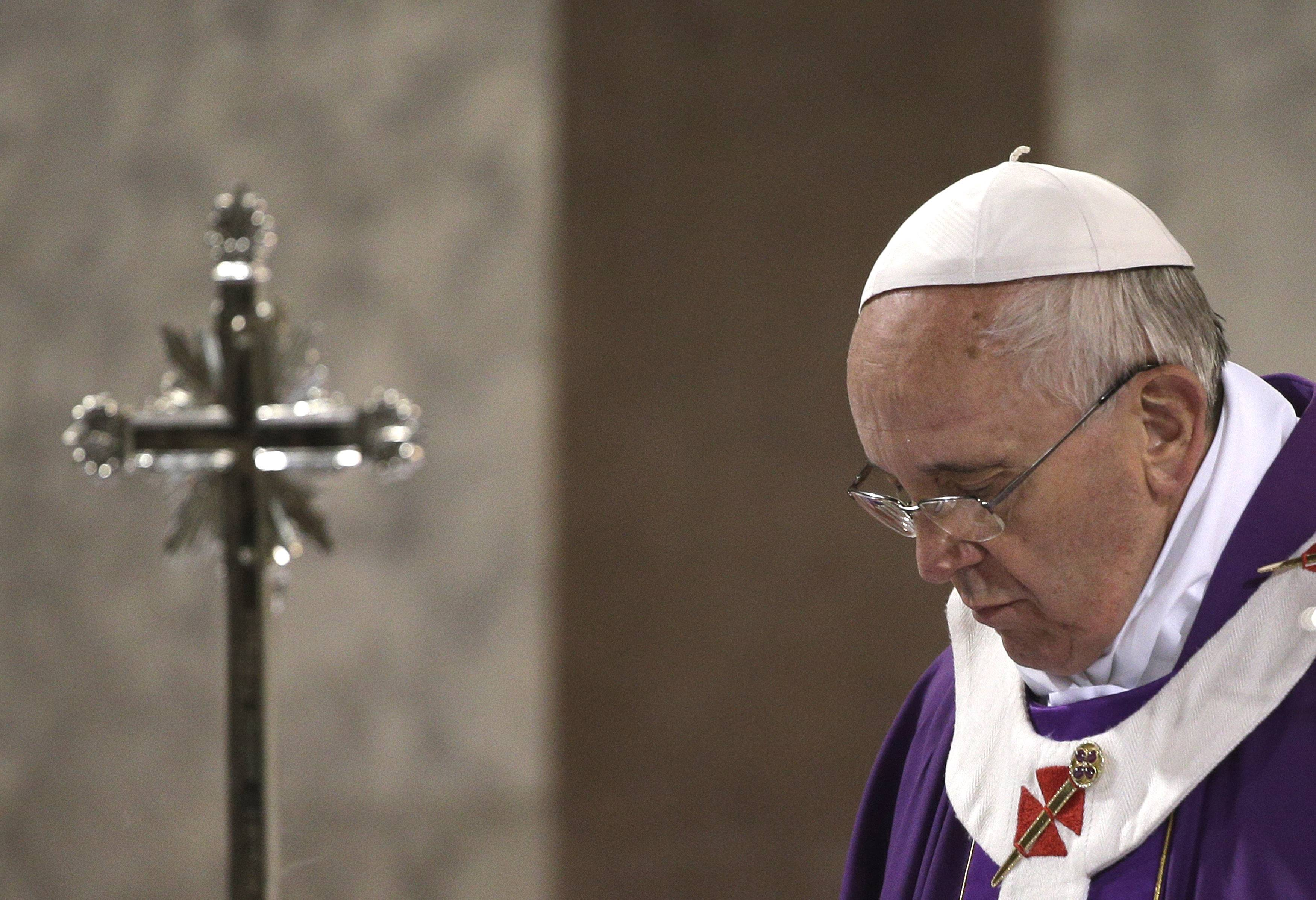 Pope Francis celebrates the Ash Wednesday mass at the Santa Sabina Basilica in Rome.