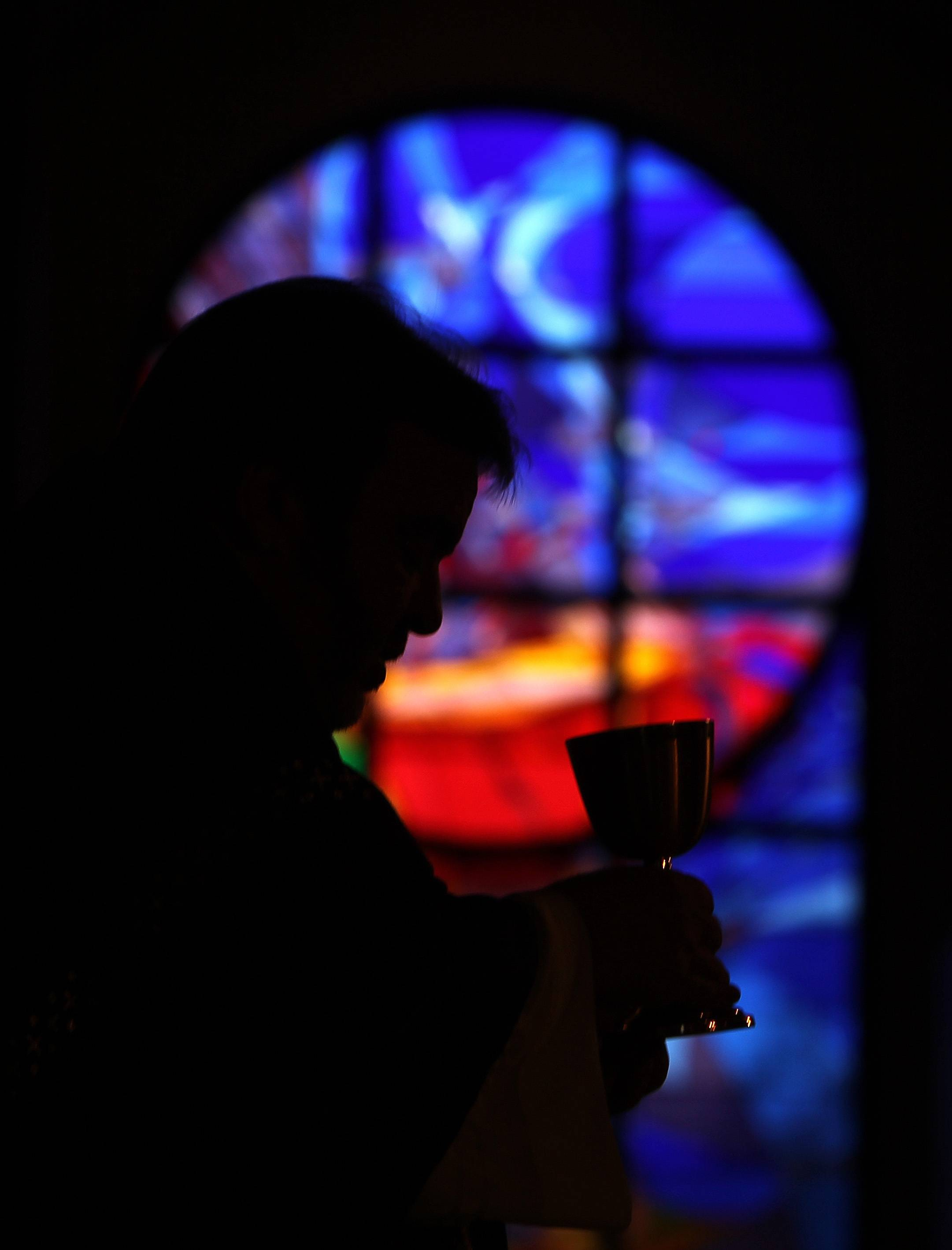 Rev. Tom Rafferty leads communion during an Ash Wednesday service at St. Anthony of Padua Catholic Church in The Woodlands, Texas.