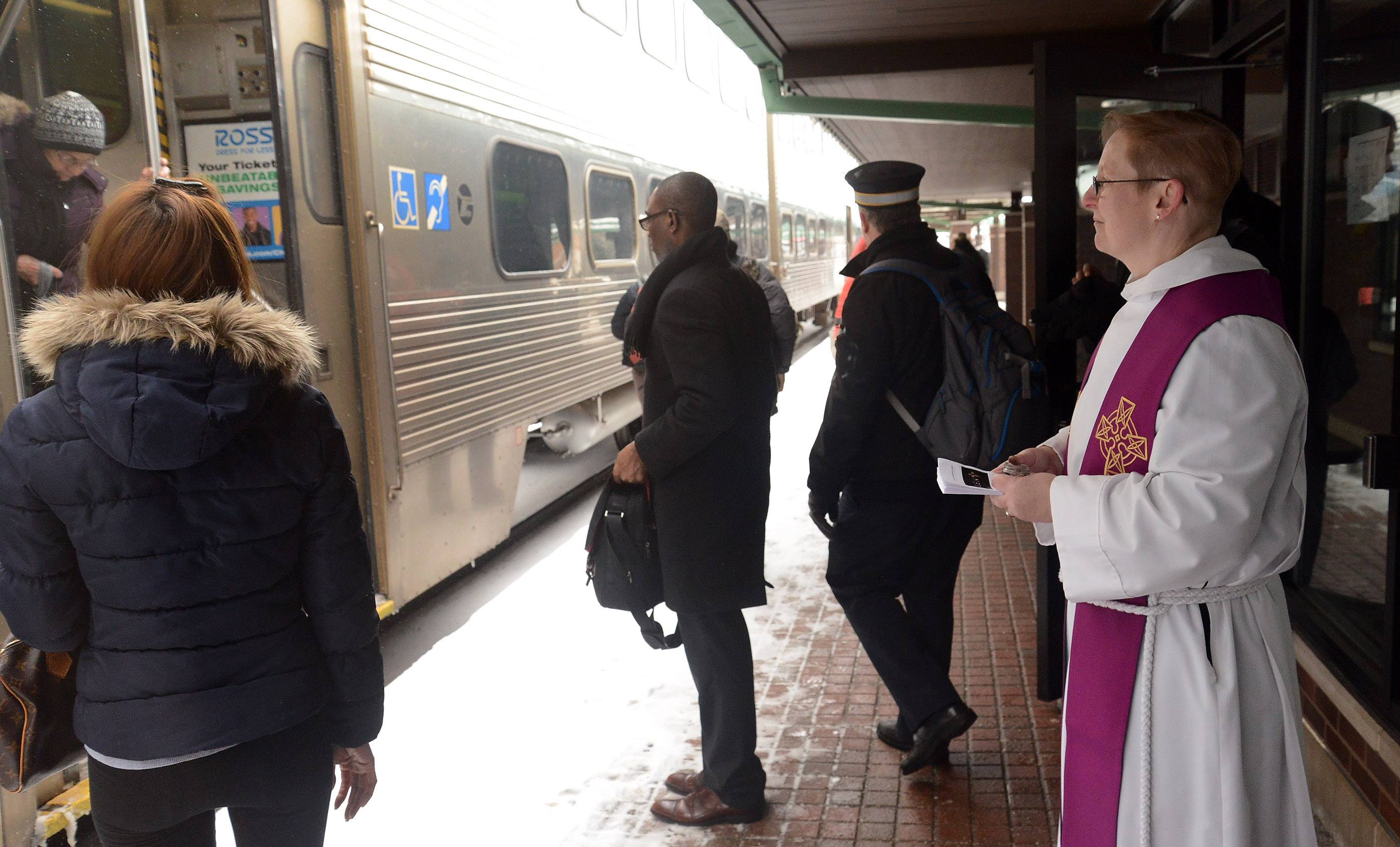 "Rev. M.E. Eccles of St. Martin's Episcopal Church in Des Plaines provided ""ashes to go"" Wednesday at the Des Plaines Metra train station."