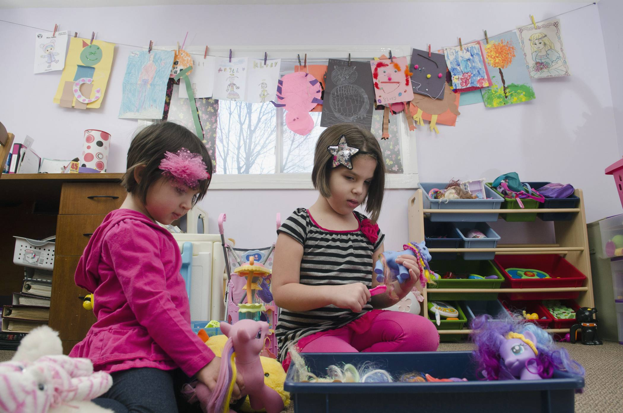 Kloey Trujillo, 5, plays with her sister Gabi, 3, at their home