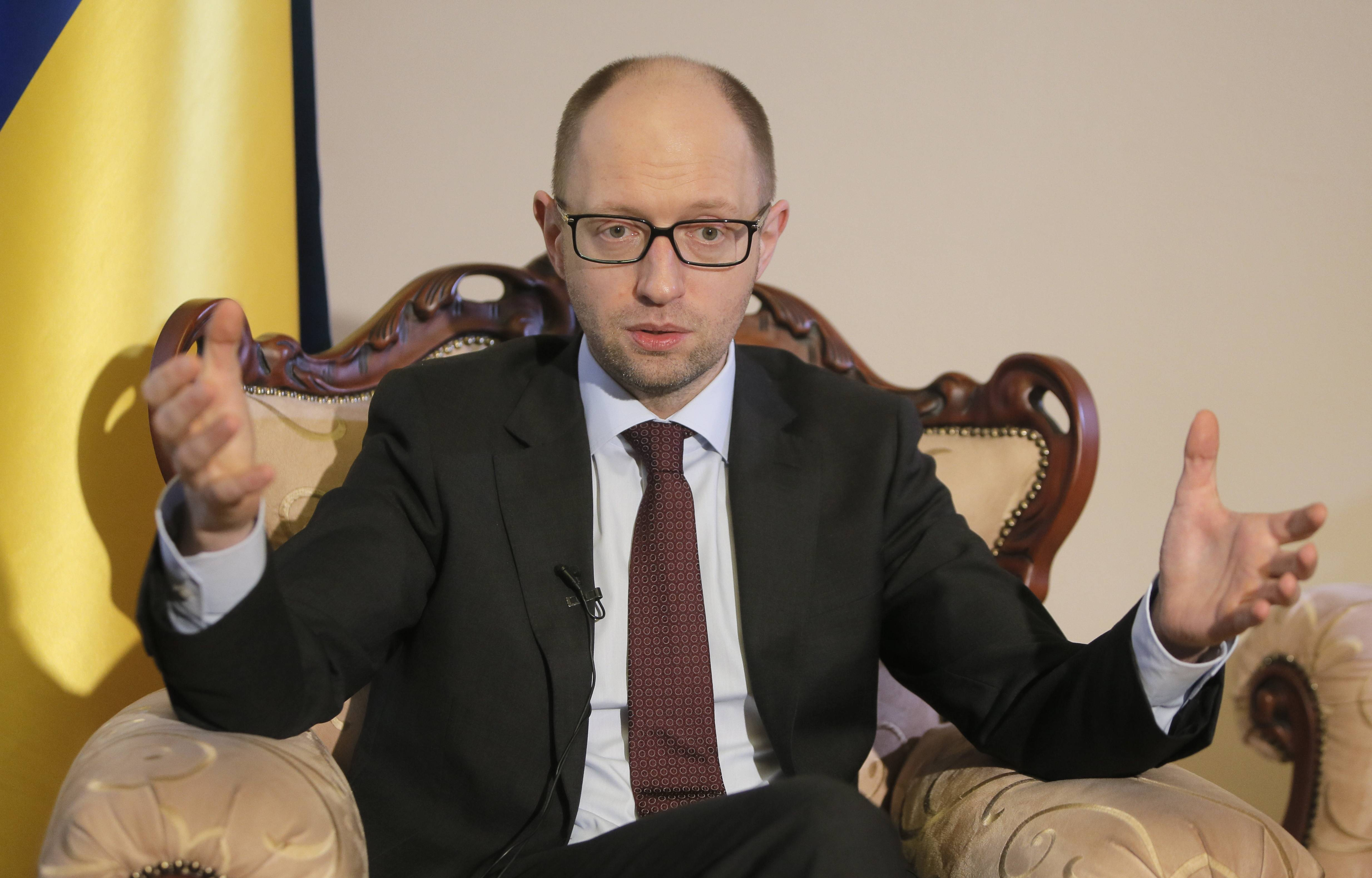 Ukrainian Prime Minister Arseniy Yatsenyuk talks with reporters during an interview with the Associated Press in Kiev, Ukraine, Wednesday, March 5, 2014. Yatsenyuk said Wednesday that embattled Crimea must remain part of Ukraine, but may be granted more local powers.