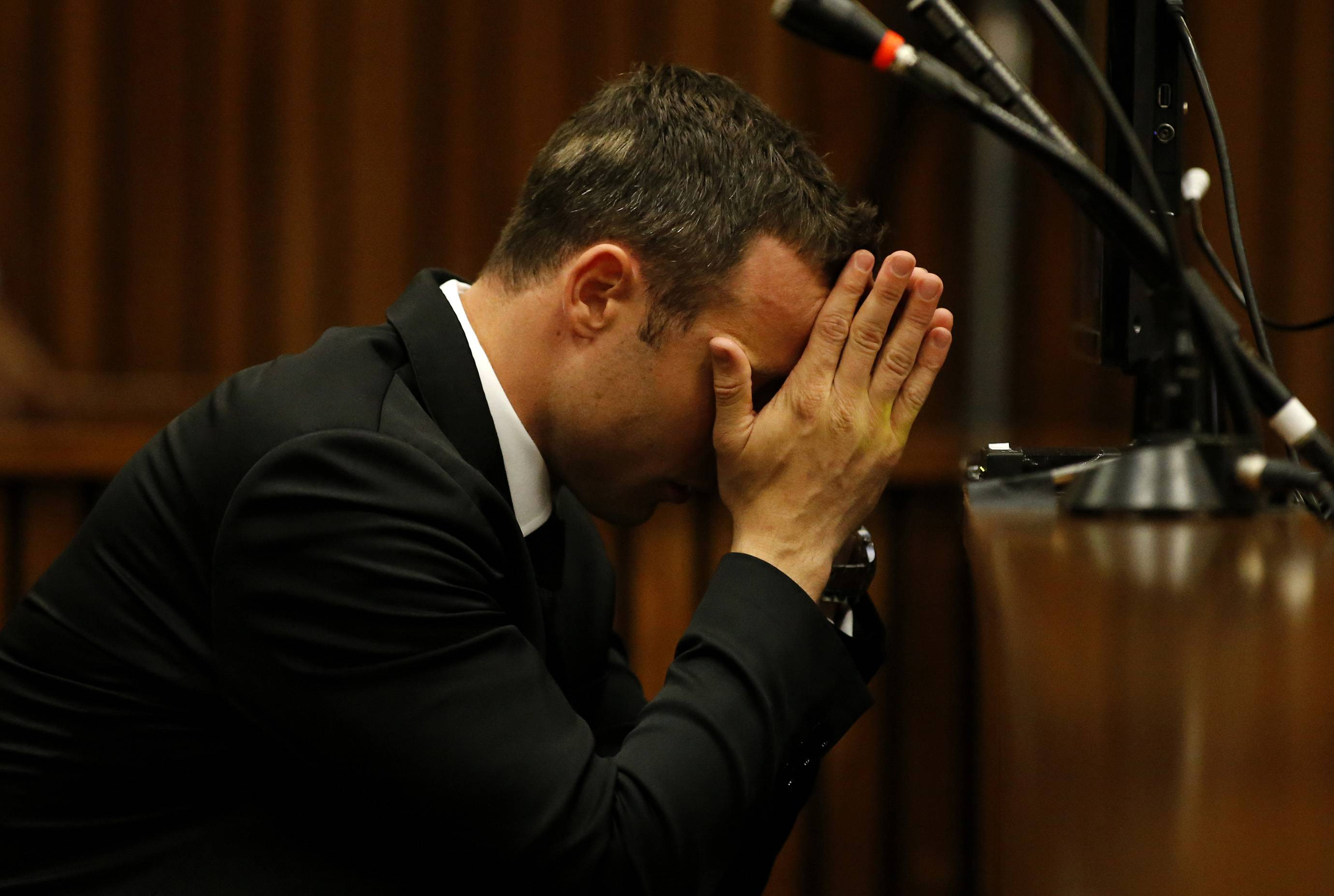 Oscar Pistorius sits in the dock in court on the third day of his trial at the high court in Pretoria, South Africa, Wednesday. Pistorius is charged with murder for the shooting death of his girlfriend, Reeva Steenkamp, on Valentine's Day in 2013.
