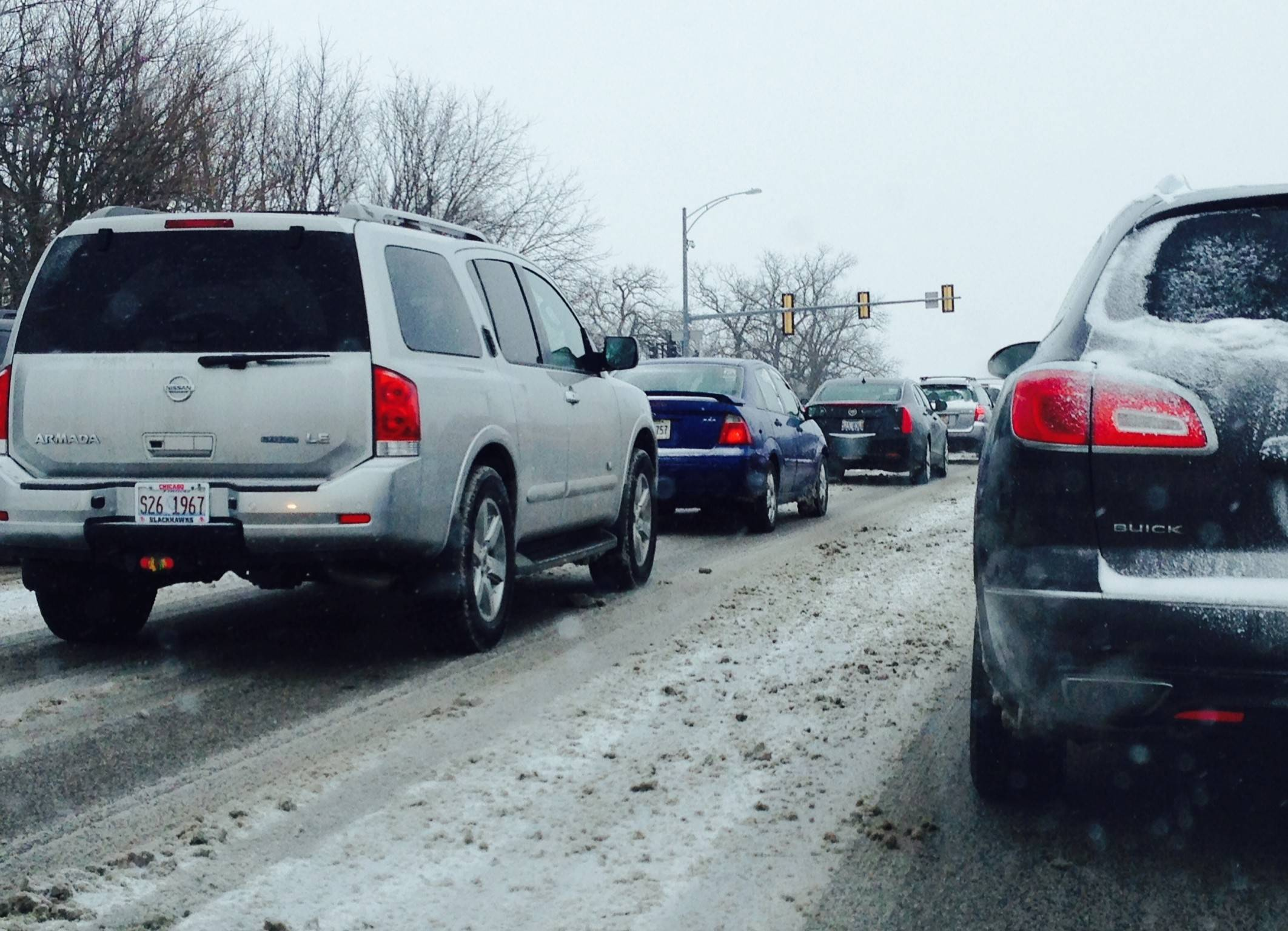 Overnight and morning snow slows traffic on Randall Road this morning.