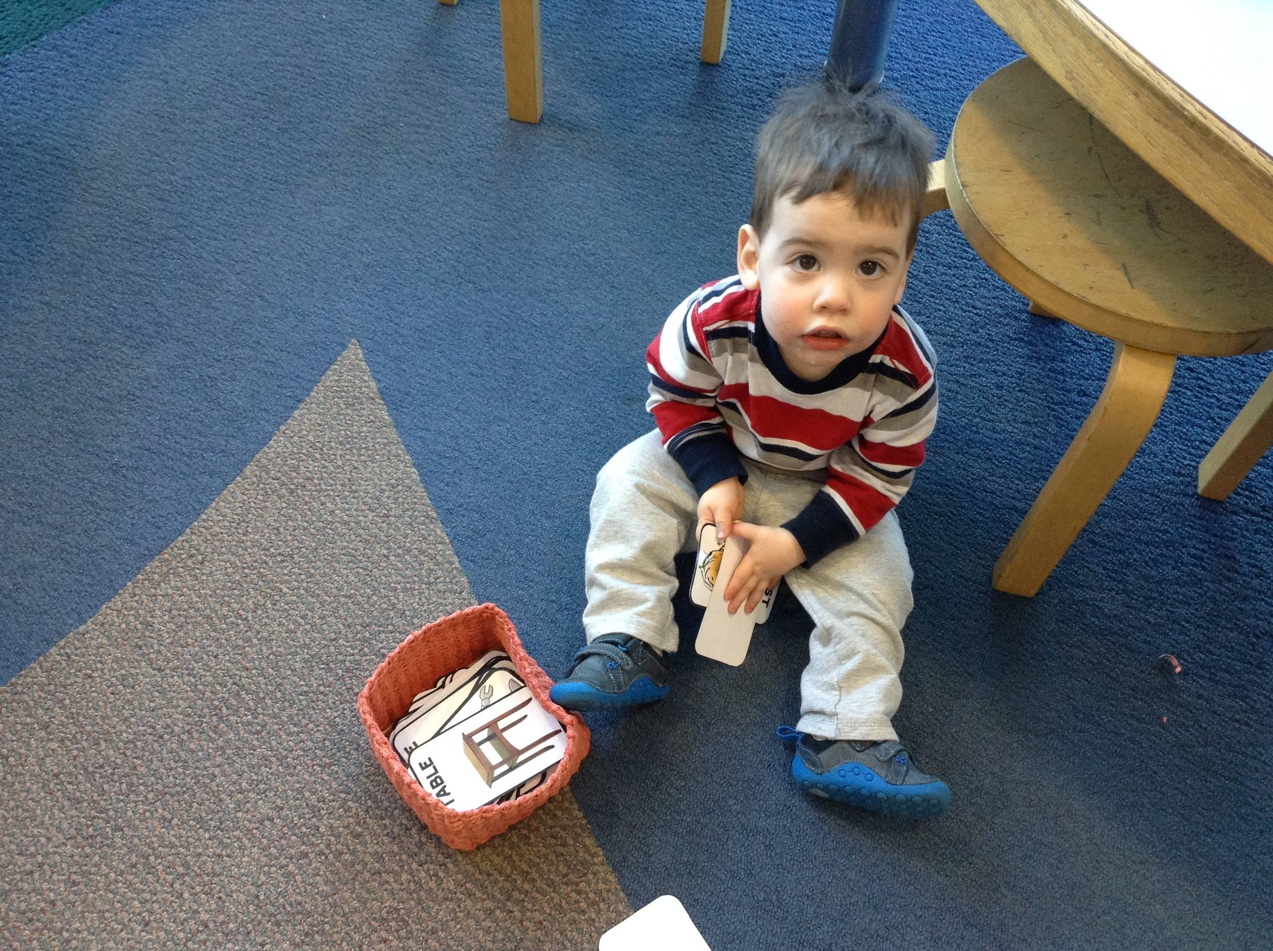Mason Silverman, 19 months, plays with cards in the children's department at the Wauconda Area Library.