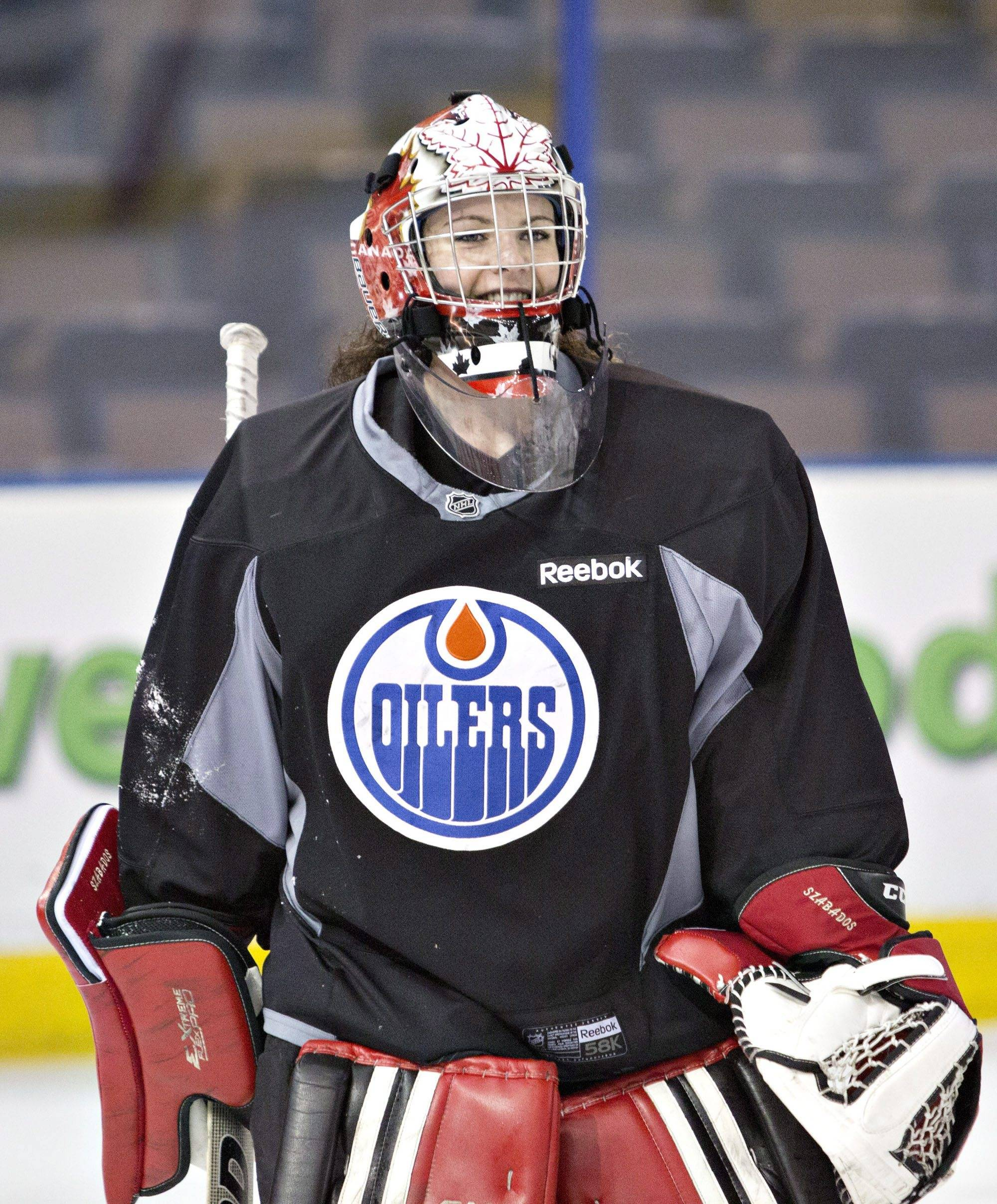 Canadian Olympic women's team goalie Shannon Szabados practices with the Edmonton Oilers NHL hockey team in Edmonton, Alberta, Wednesday, March 5, 2014.