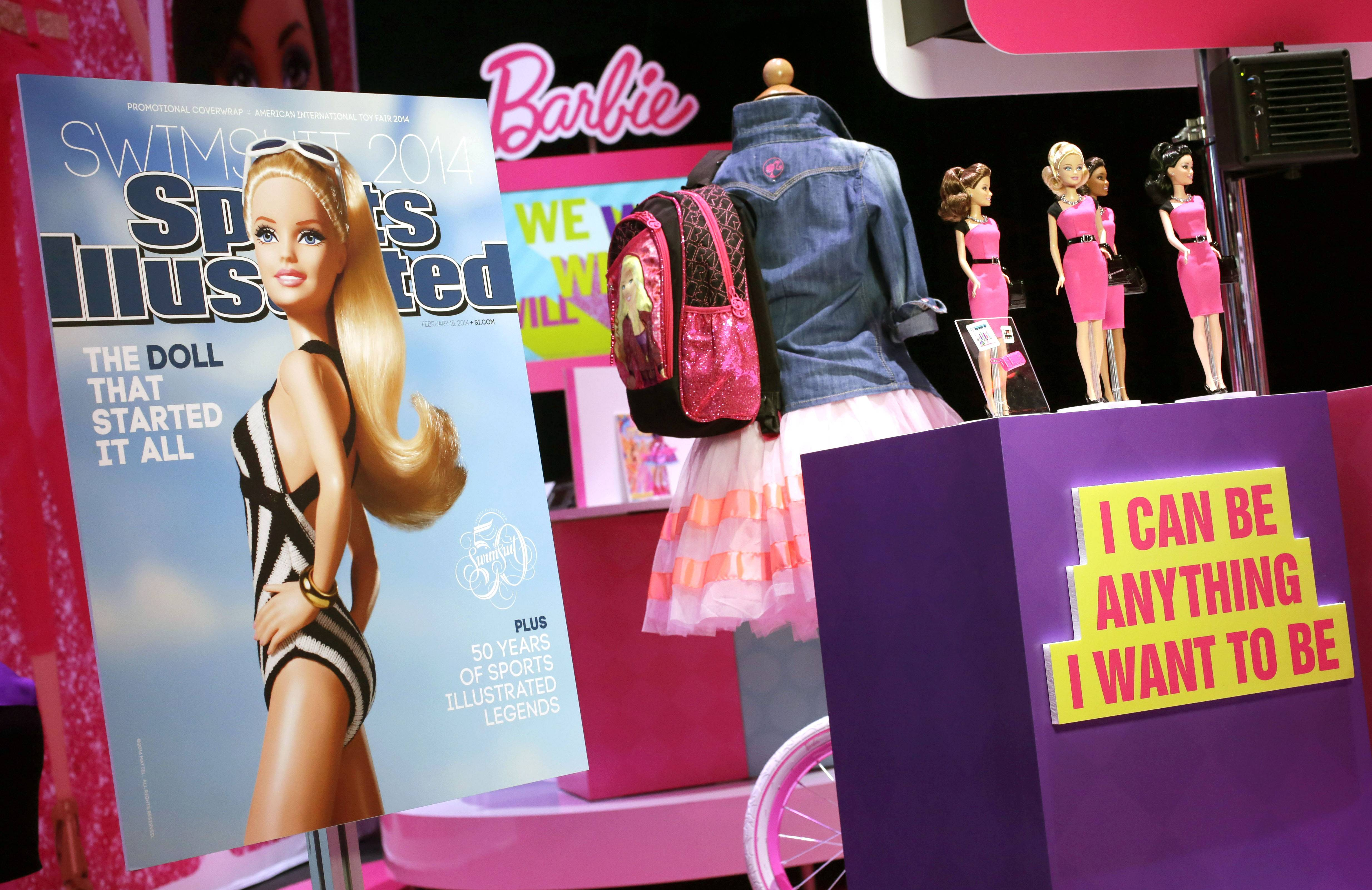 A mock-up cover of Barbie on a Sports Illustrated swimsuit issue is displayed at the Mattel booth at the American International Toy Fair in New York last month. A few weeks after her foray into the Sports Illustrated swimsuit edition, Barbie is entangled in controversy again, this time over her ties with the Girl Scouts.