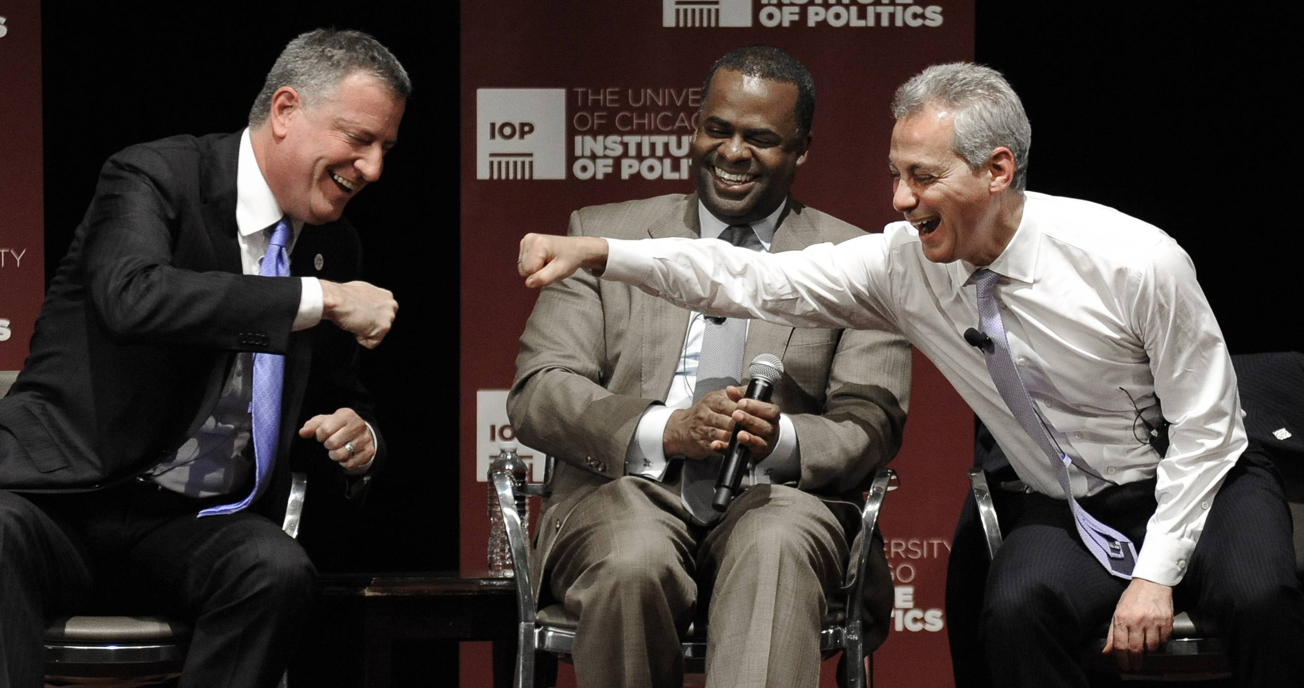 Chicago Mayor Rahm Emanuel, right, jokes with New York Mayor Bill De Blasio, left, to the amusement of Atlanta Mayor Kasim Reed on Thursday during a mayoral panel discussion at the University of Chicago.