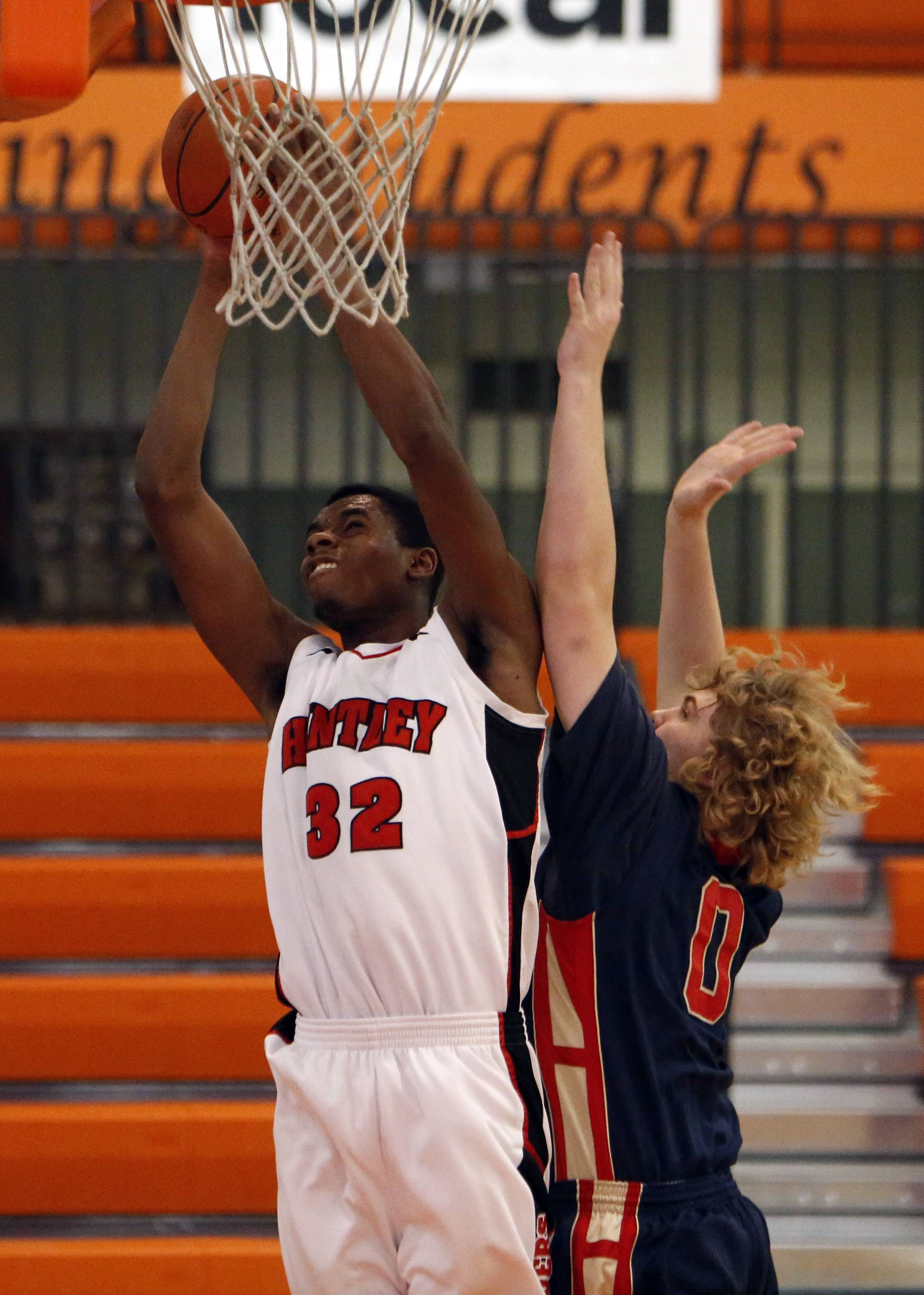 Huntley senior Amanze Egekeze is the honorary captain of the Daily Herald's Fox Valley all-area boys basketball team. ,
