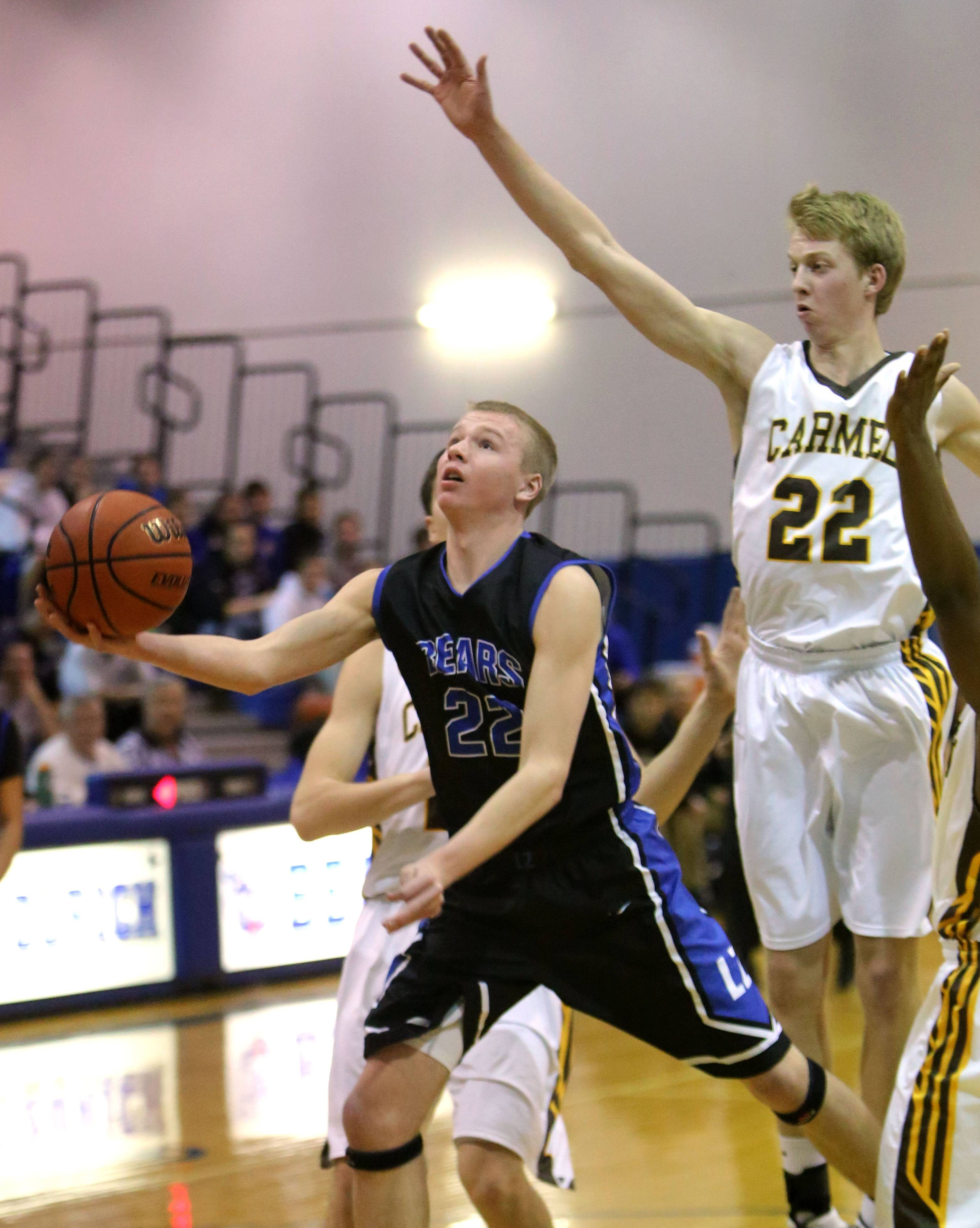 Carmel's Michael Barr defends during the 2nd annual Lake Zurich Martin Luther King Classic at Lake Zurich High School.