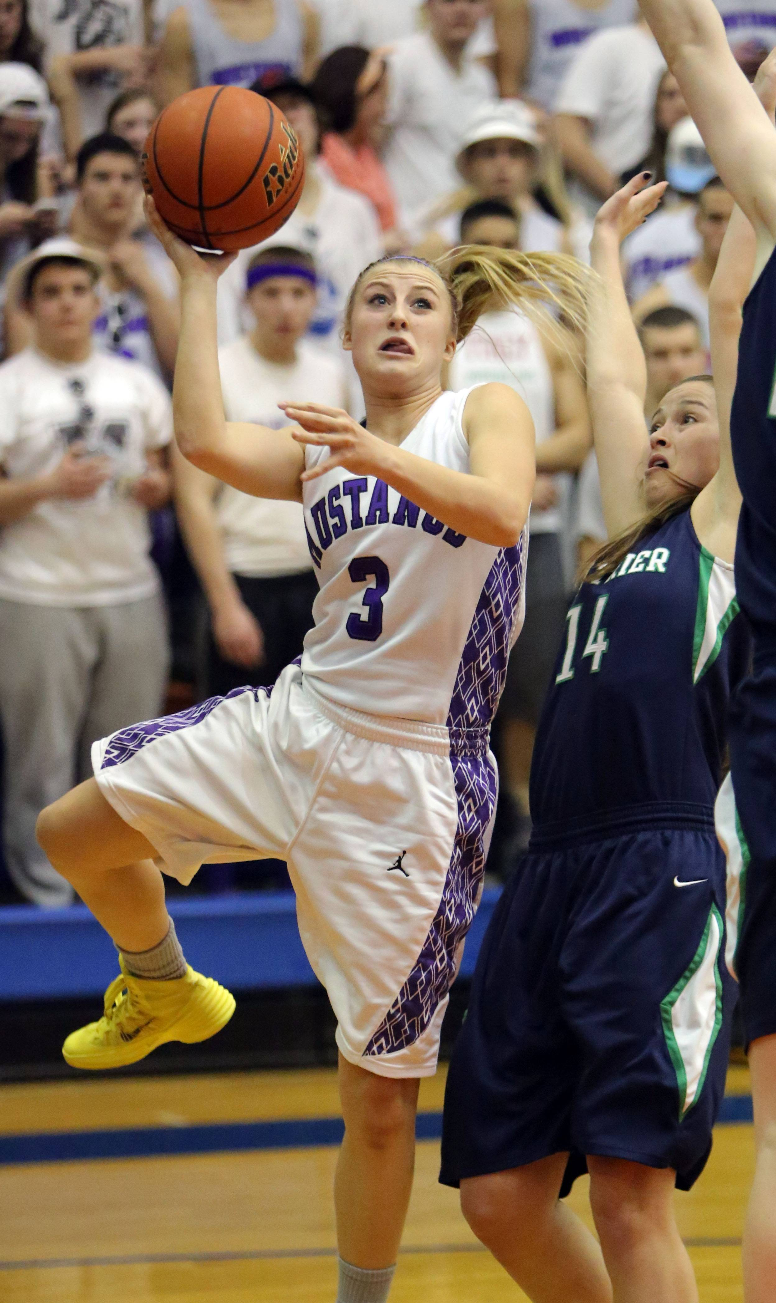 Rolling Meadows' Jackie Kemph, left, drives on New Trier's Jackie Welch in the most recent of her big-game triumphs, the Mustangs' 60-43 supersectional victory at Hoffman Estates.