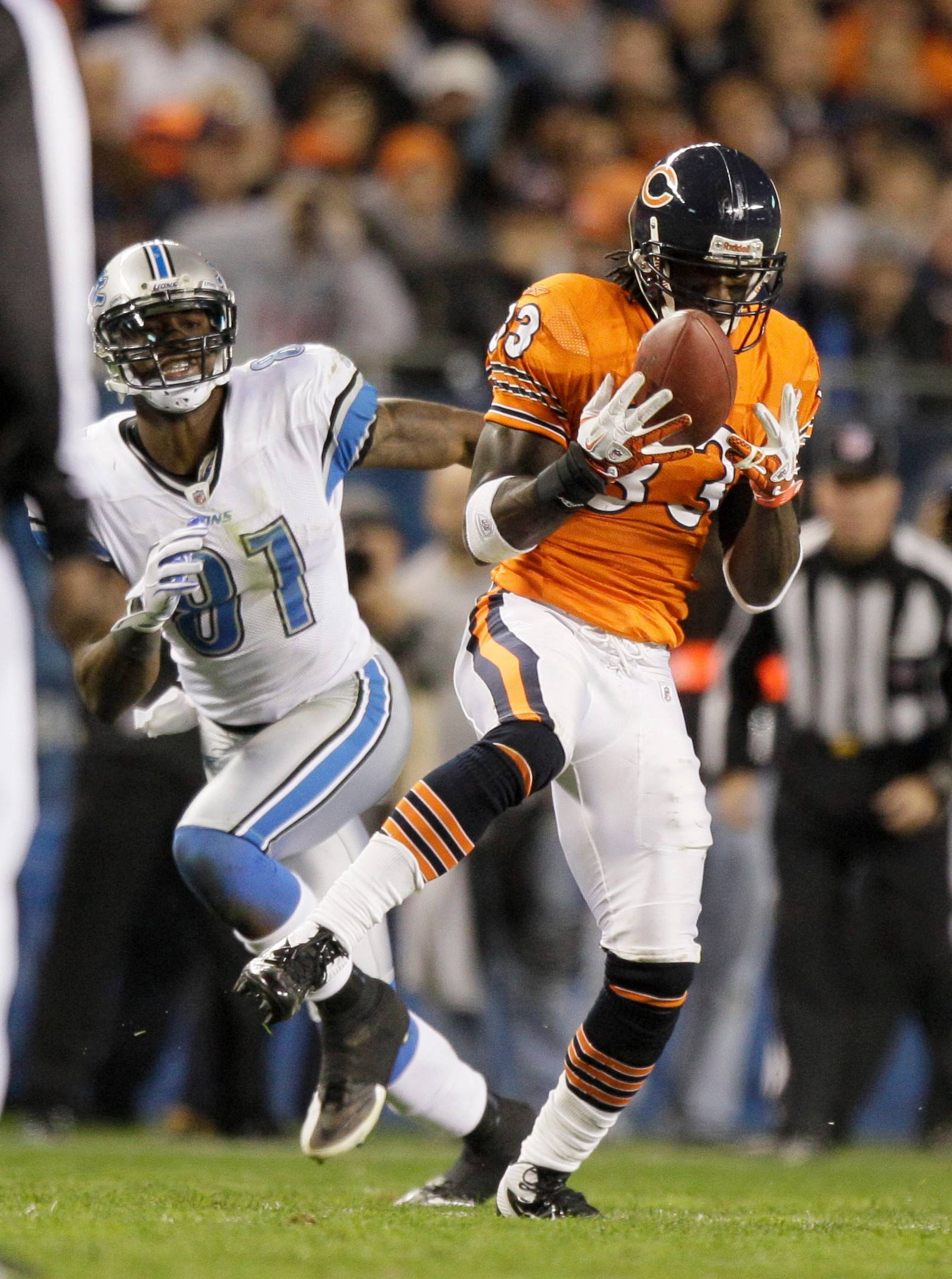 Associated Press Why should the Bears re-sign cornerback Charles Tillman? How about to cover the Lions' Calvin Johnson (81).