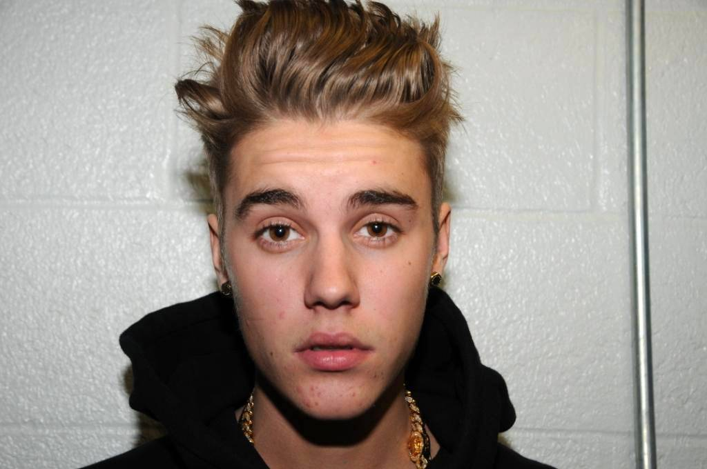 Miami prosecutors have released police video of Justin Bieber giving urine for a drug test, with sensitive portions blacked out as ordered by a judge.