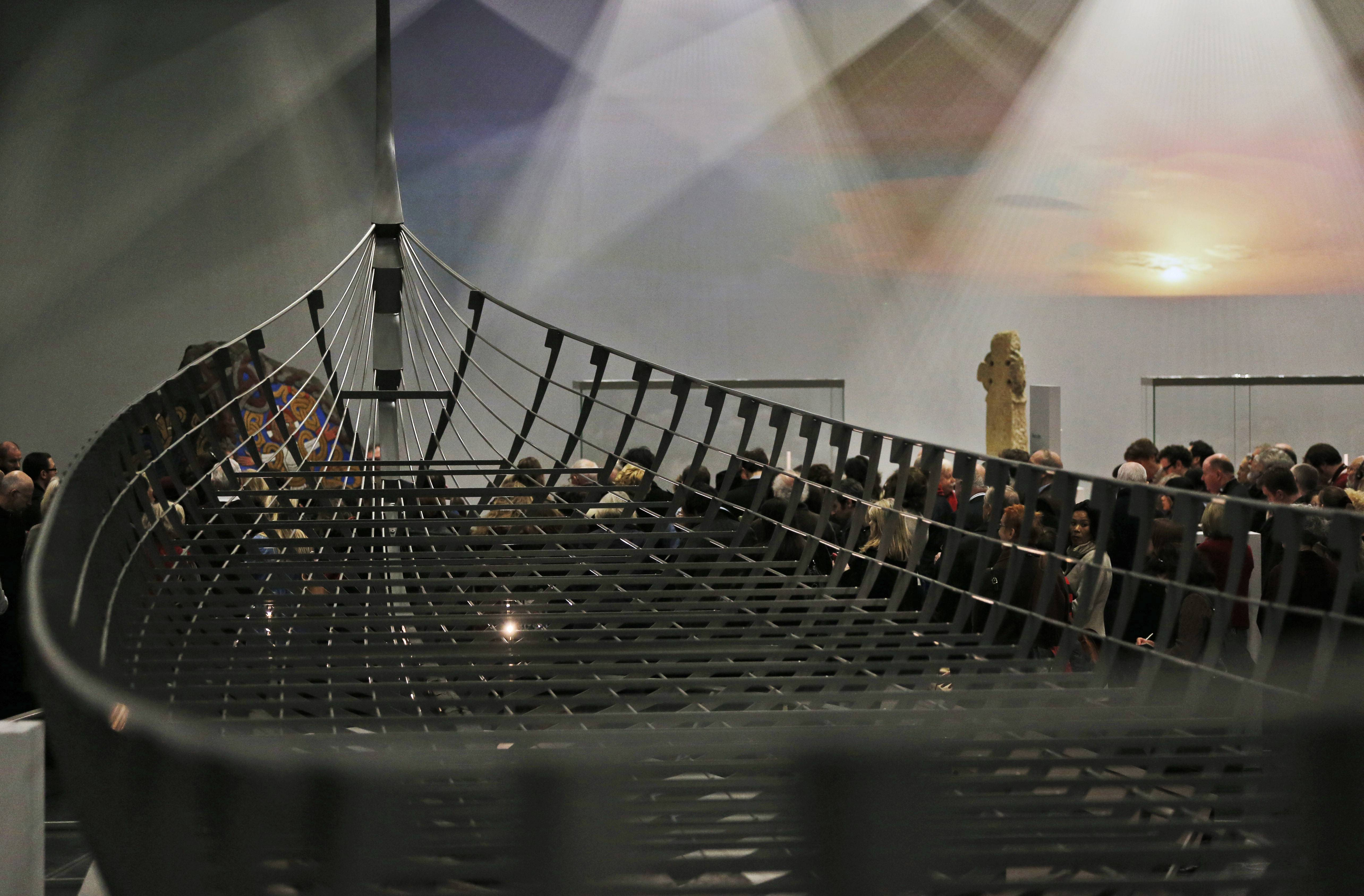 "Visitors wander around a new exhibition entitled ""Vikings: Life and Legend"" at the British Museum in London. The centerpiece of the show is the biggest Viking ship ever found, which was unearthed on the banks of a Danish fjord in 1997. It is 120 feet long and had 40 pairs of oars."