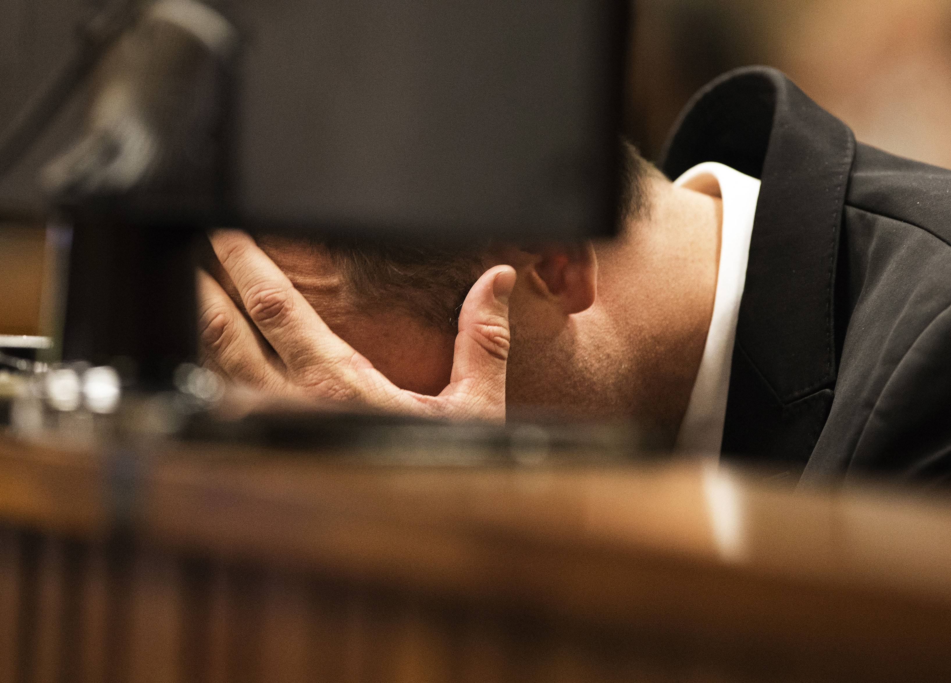 Oscar Pistorius, puts his hands to his head while listening to evidence from a witness speaking about the morning of the shooting of his girlfriend Reeva Steenkamp, in court on the fourth day of his trial at the high court in Pretoria, South Africa, Thursday.