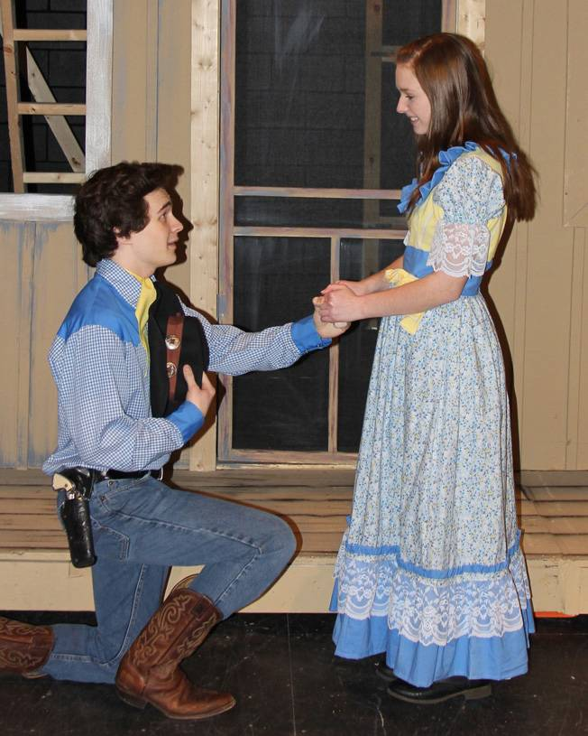 "Curly, played by Joseph Beaty, proposes to Laurey, played by Maddie Hayes, during rehearsal for South Elgin High School's production of ""Oklahoma."""